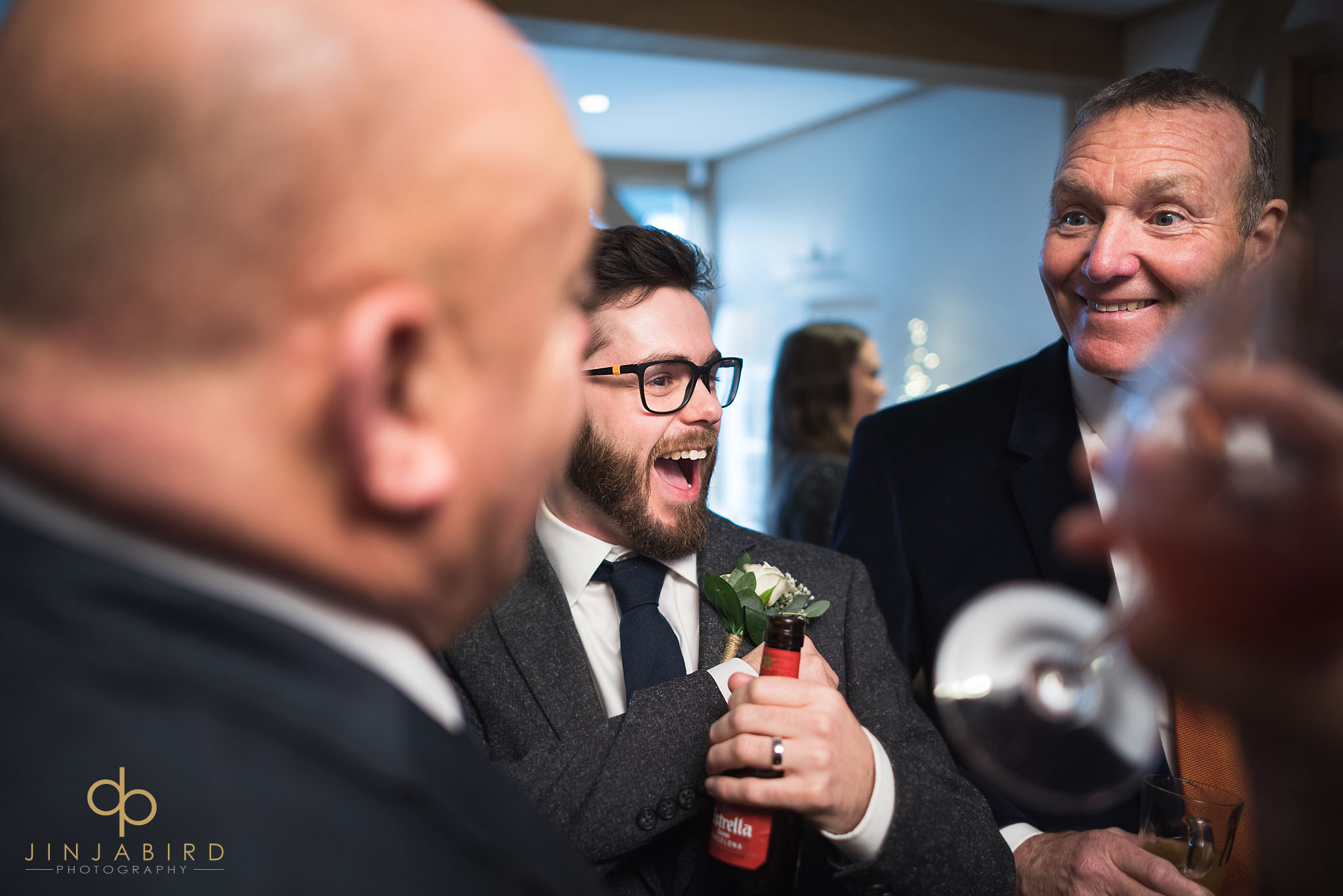 groom laughing with mates