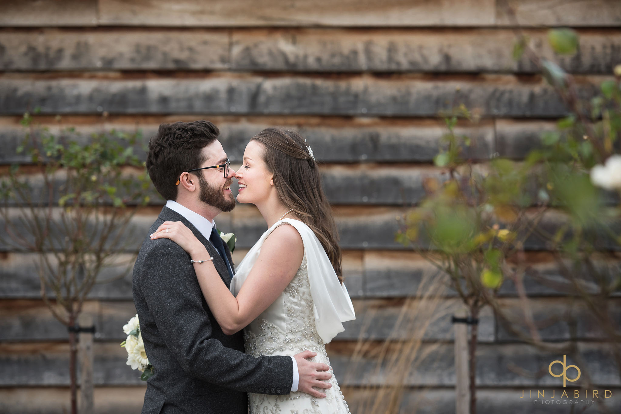 bride with groom in garden bassmead manor