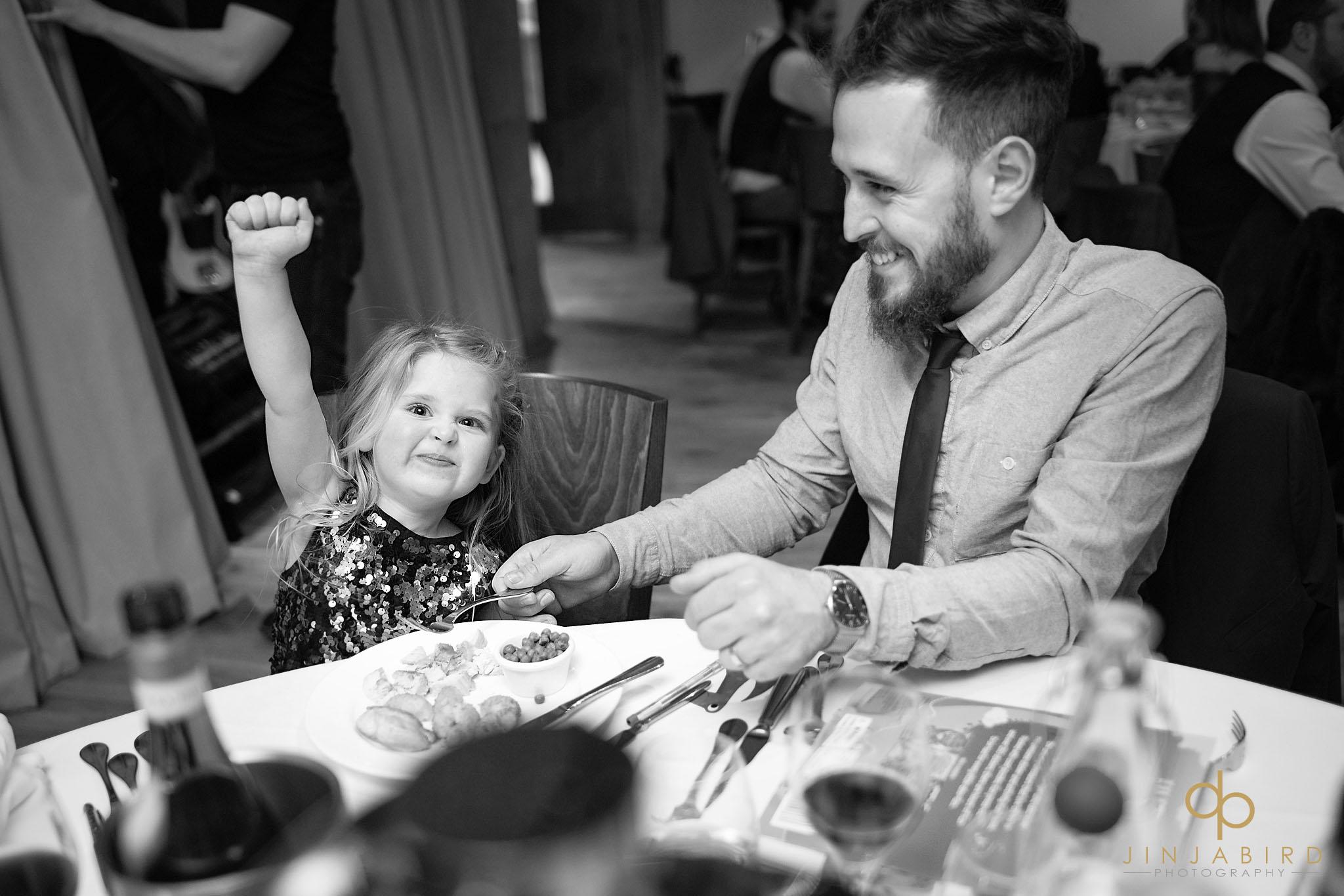small girl having dinner