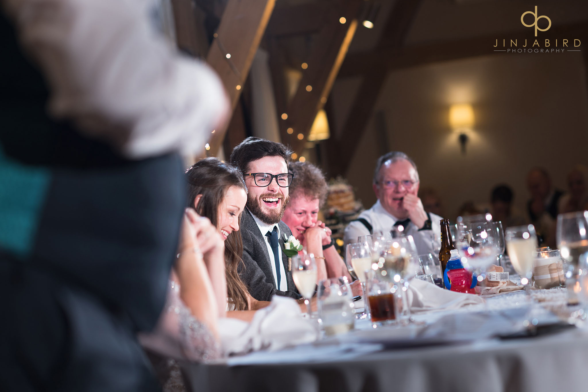 groom laughing at speeches