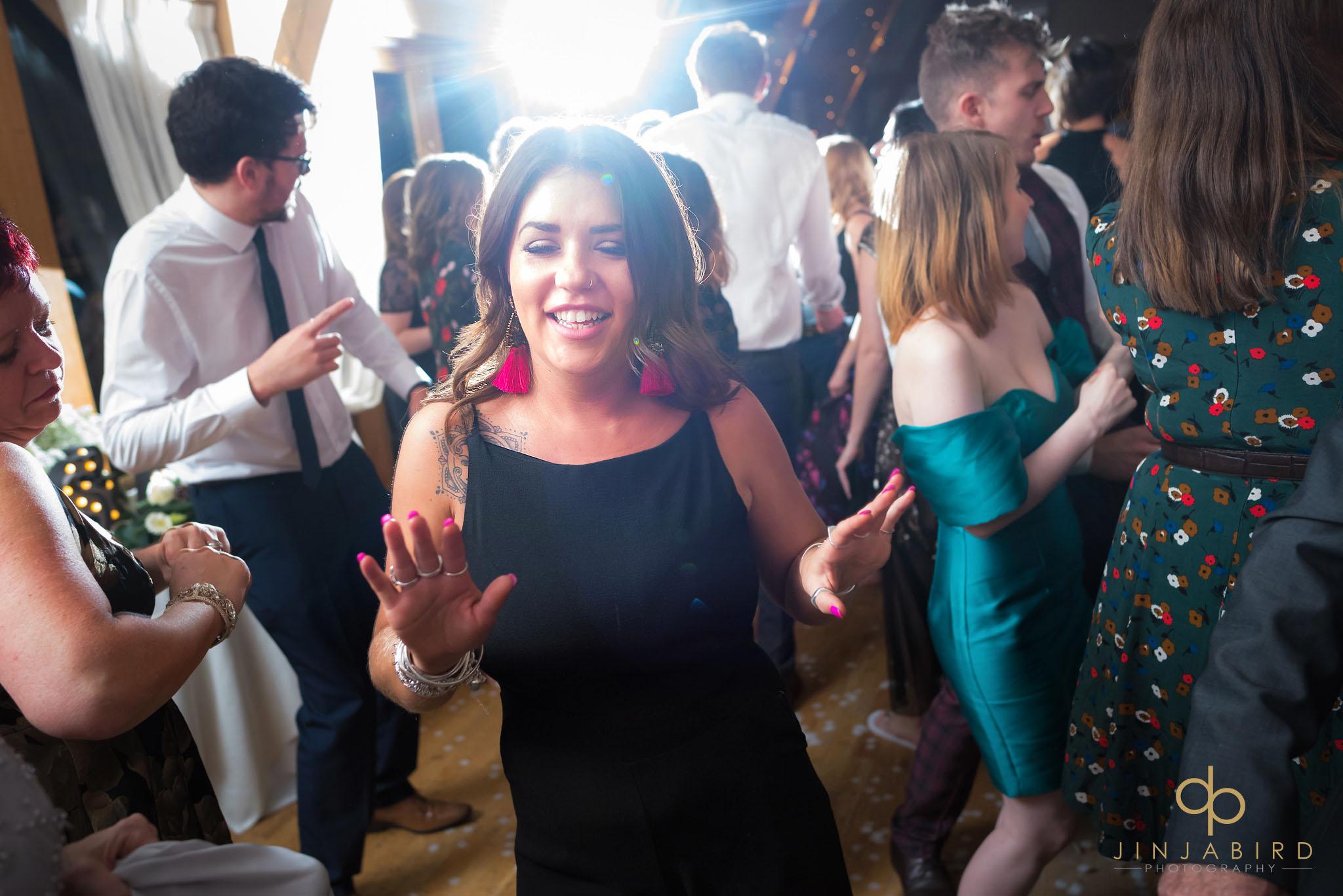 wedding guest dancing at wedding