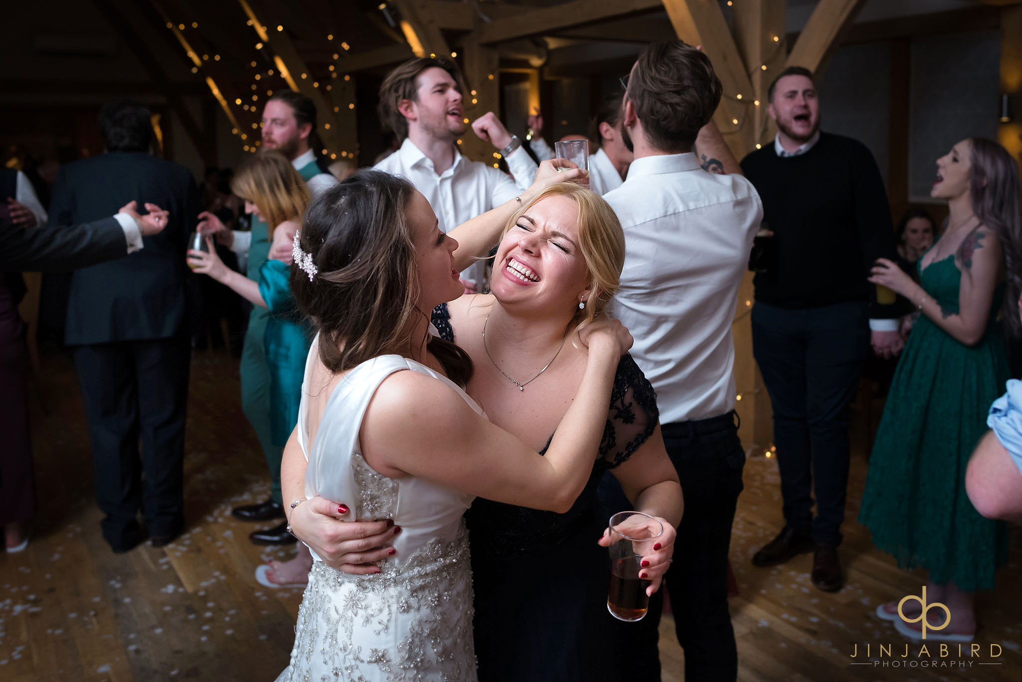 bride dancing with sister