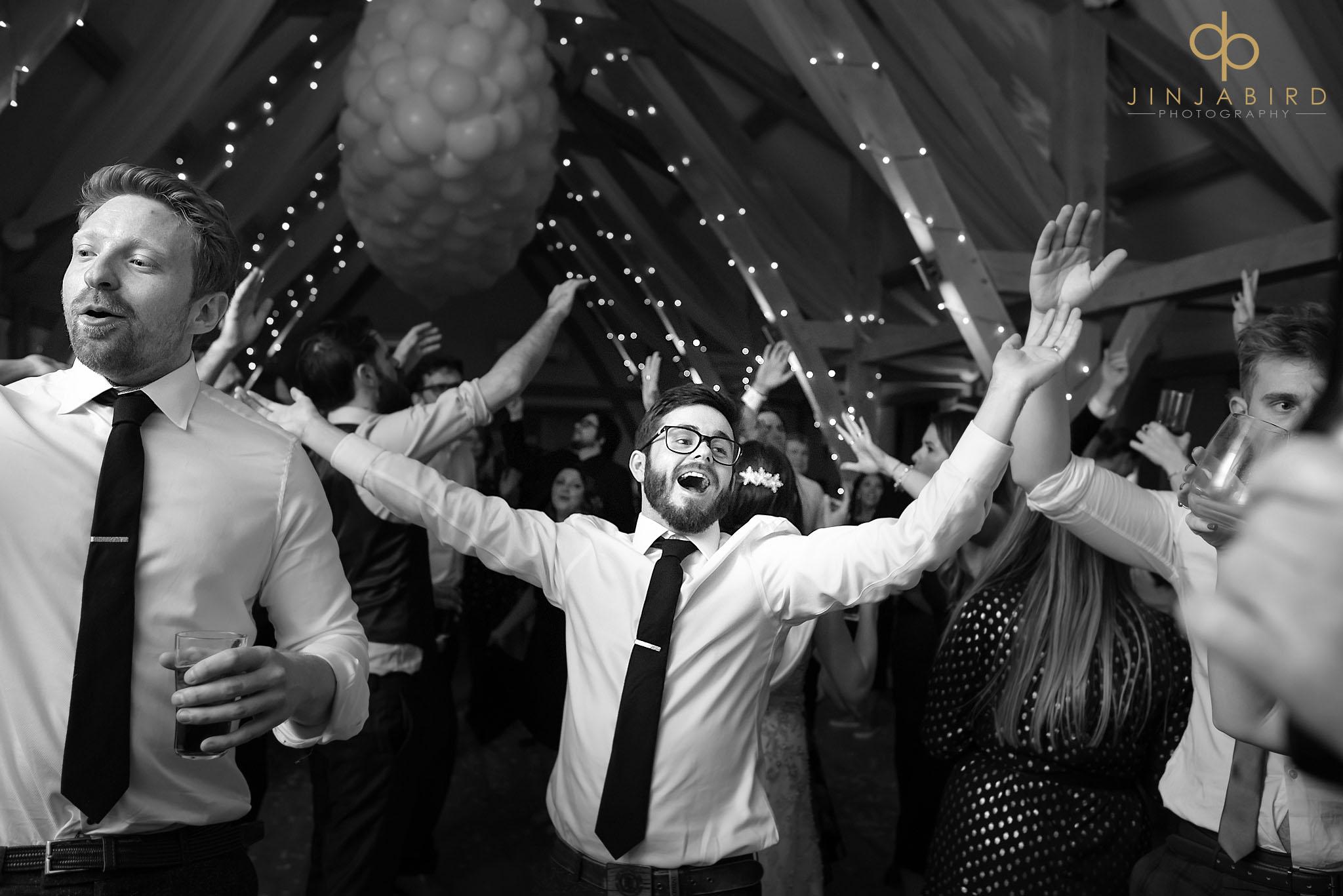 groom dancing with friends