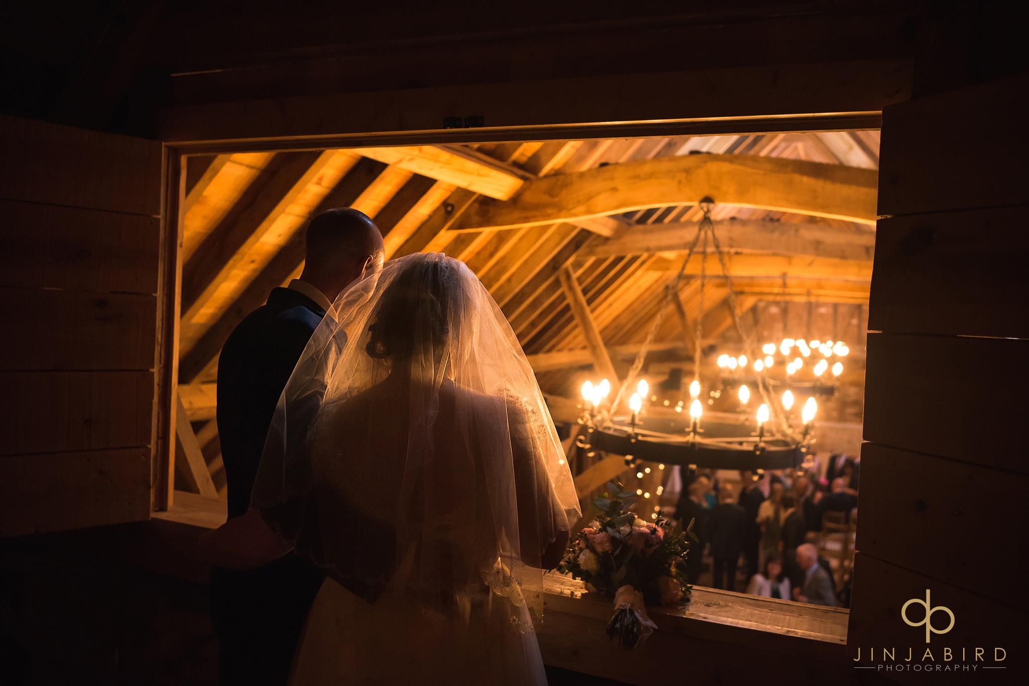 bride-and-groom-in-gallery-rickety-barn-bassmead