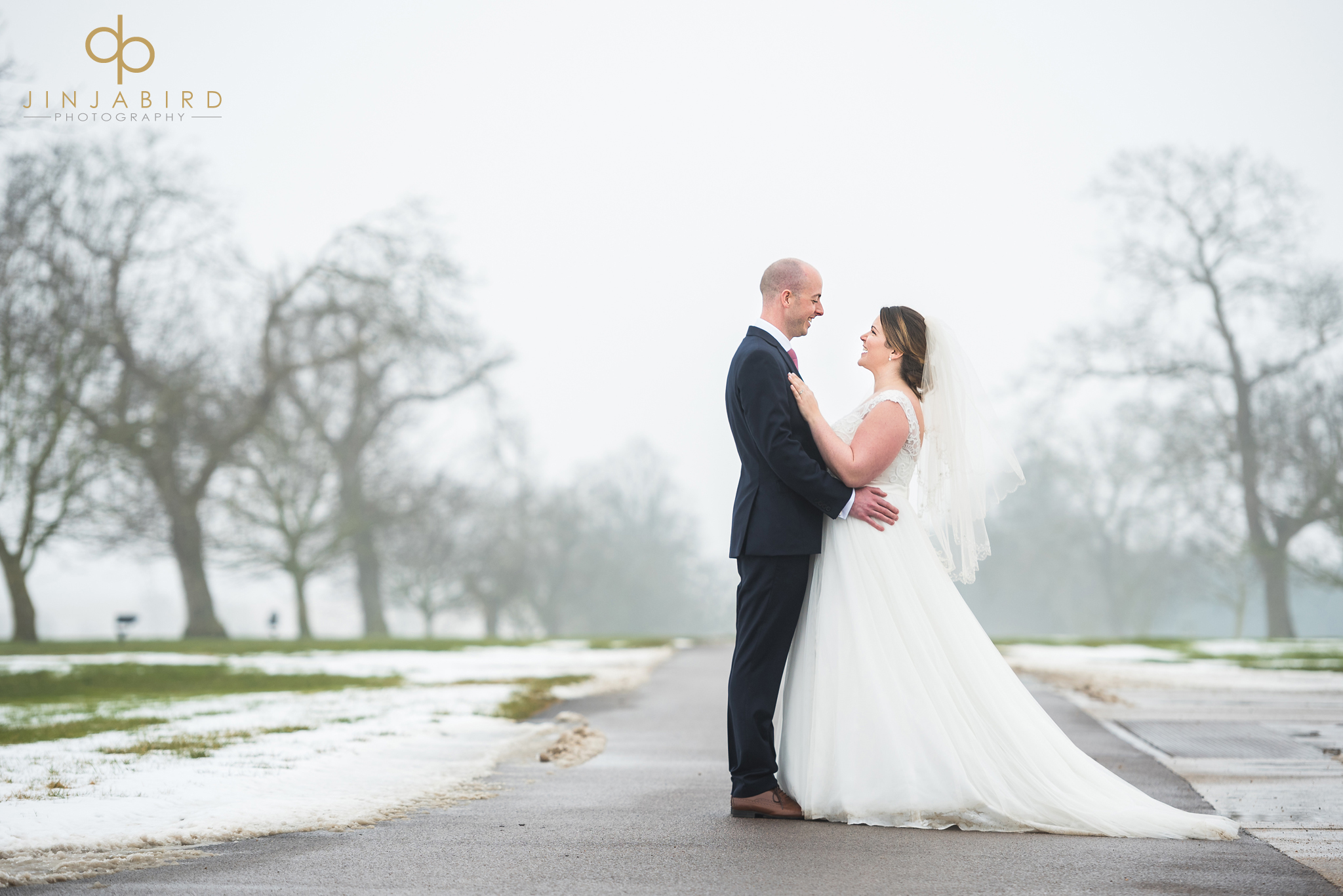 bride-and-groom-on-drive-in-snow-bassmead-manor