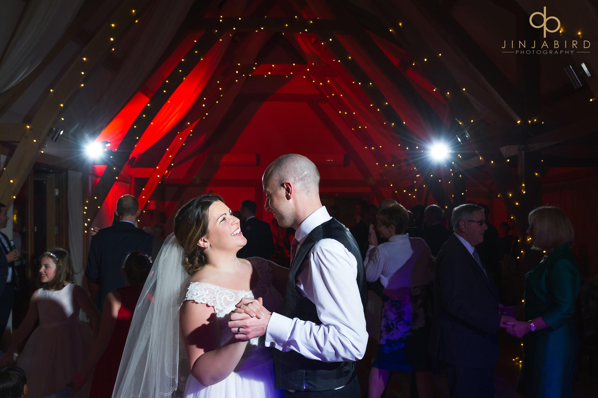 bride-loving-groom-while-dancing