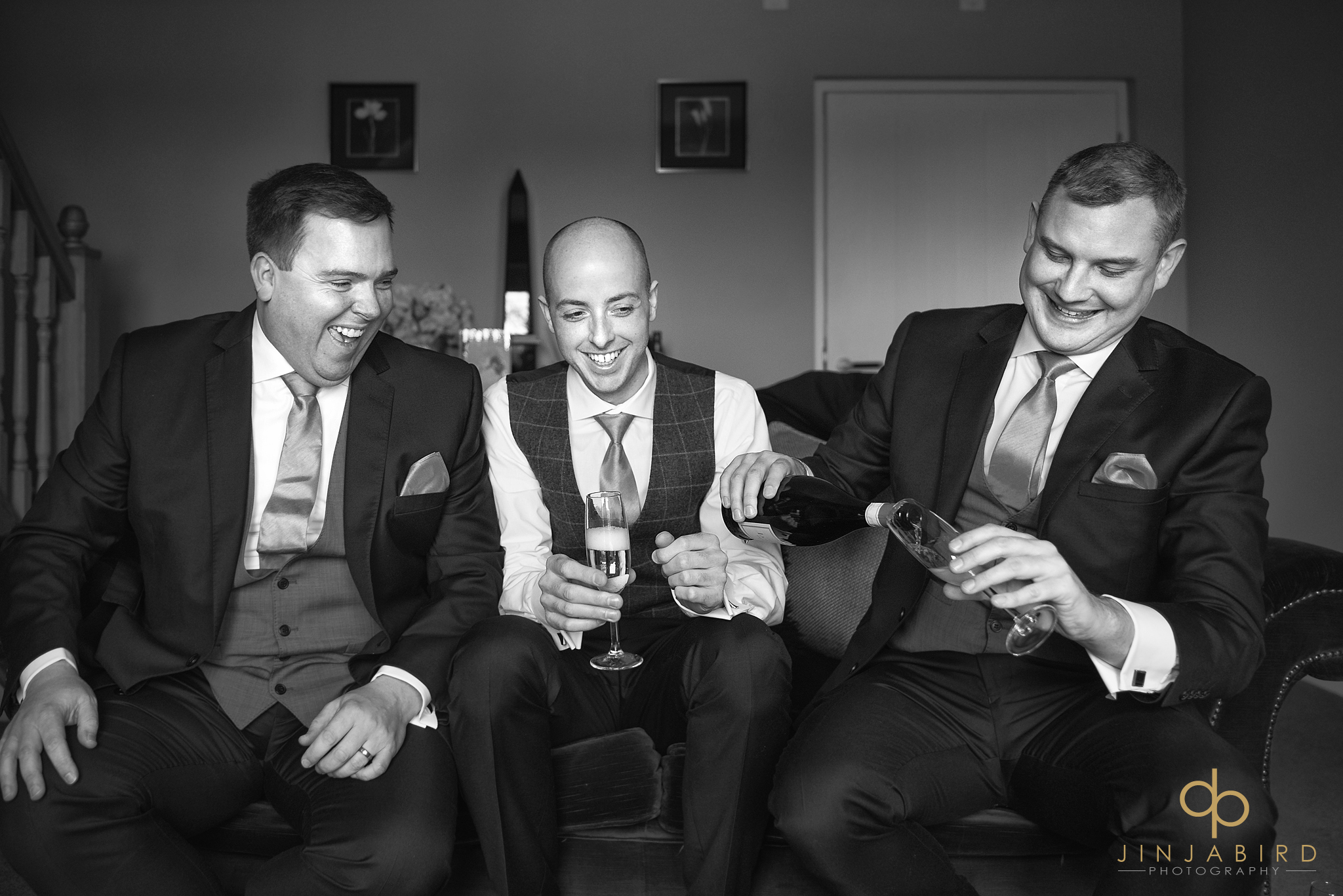 groom-drinking-champagne-with-groomsmen