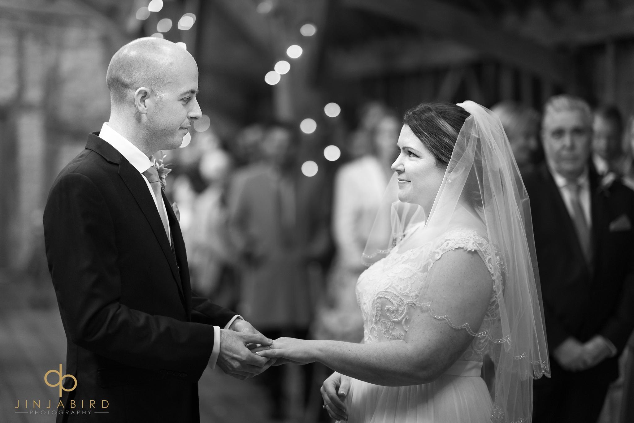 groom-holding-brides-hand
