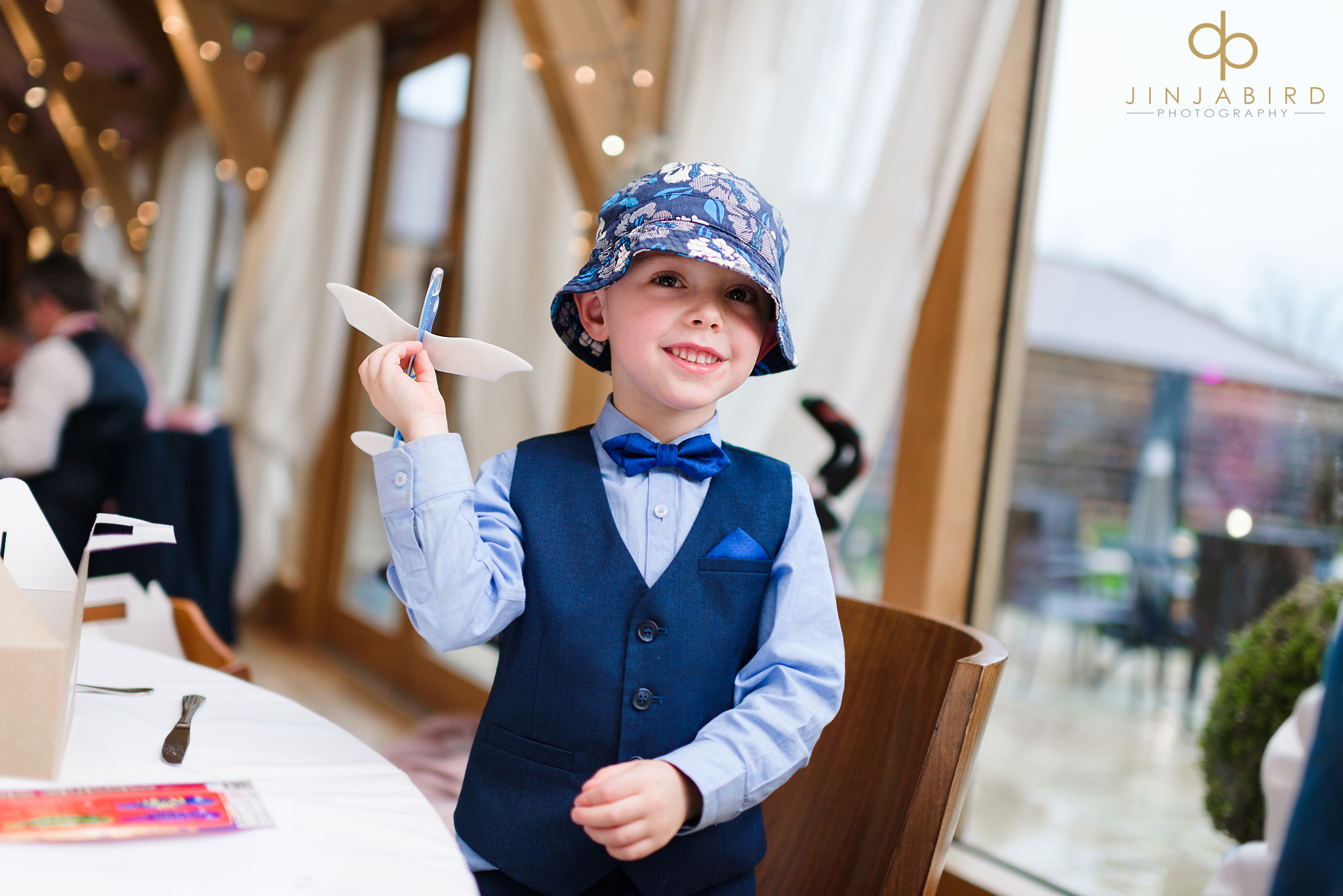 boy with funny hat at wedding