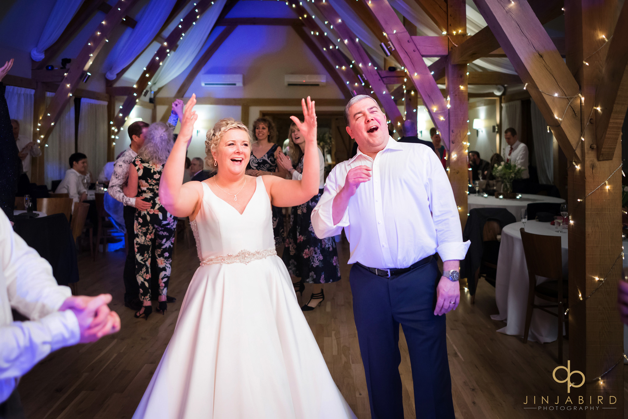 bride and groom cheering band