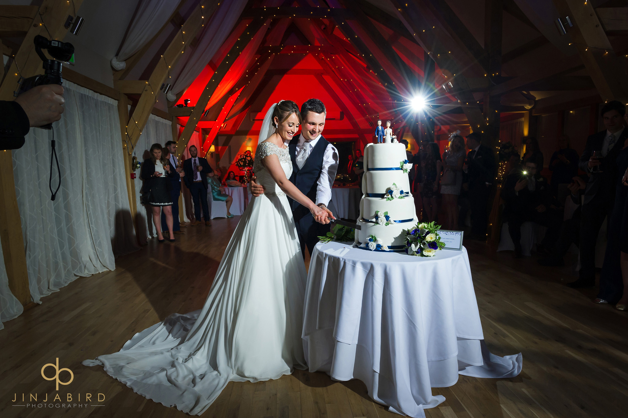 bride cutting cake with groom bassmead manor
