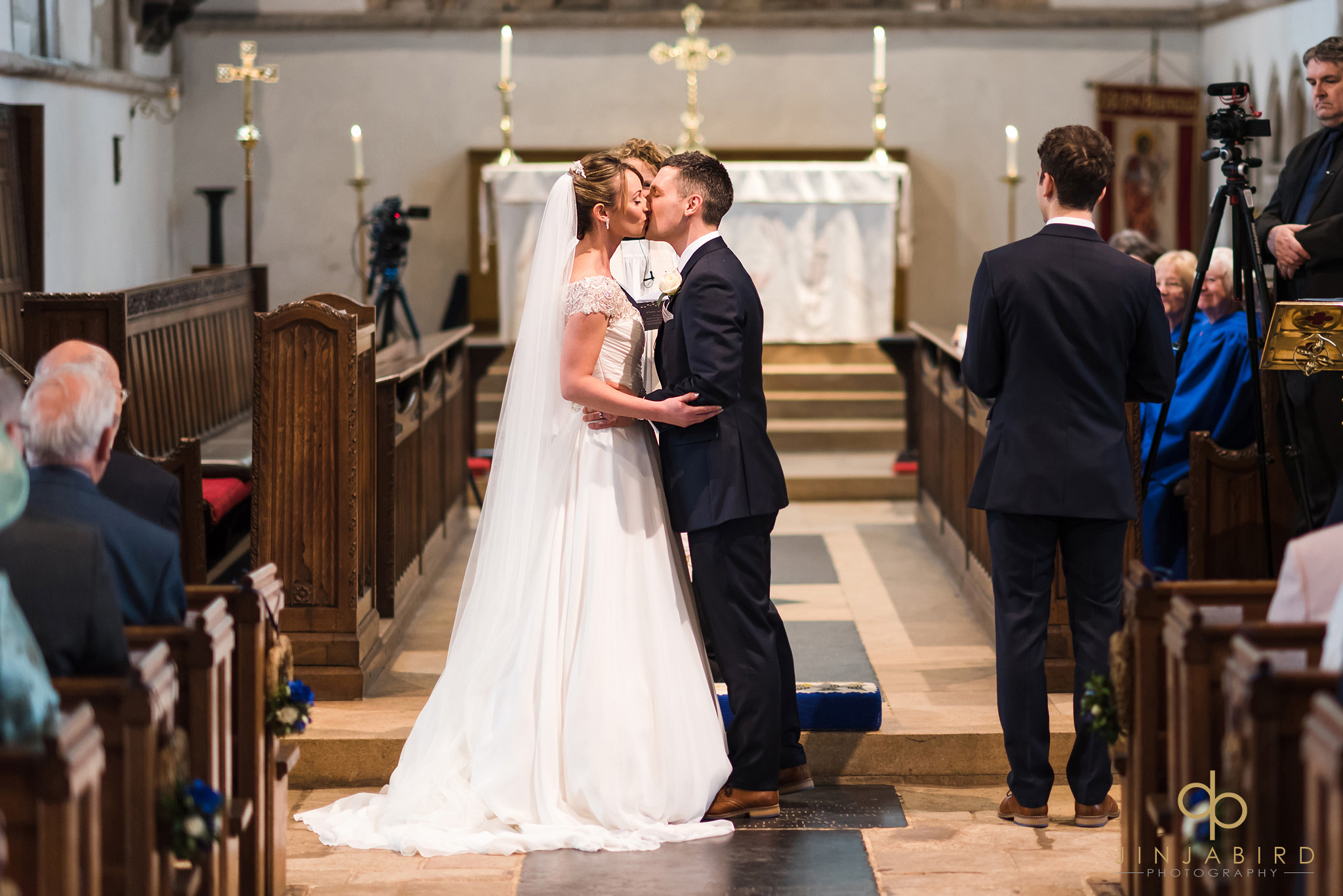bride and groom first kiss somersham church