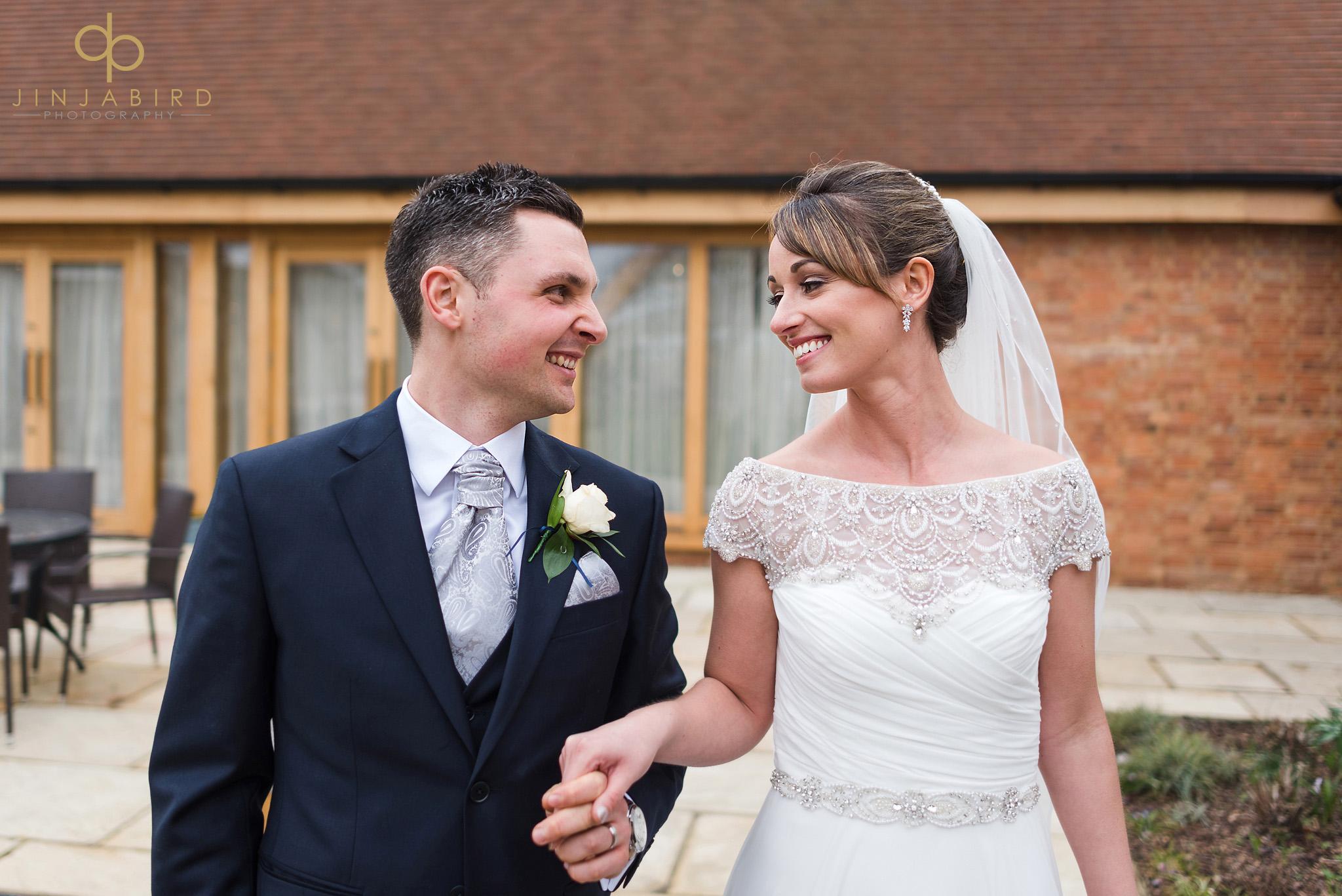 bride and groom in garden bassmead manor