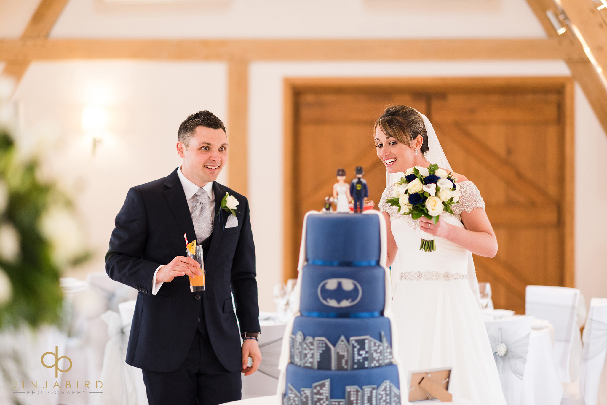 bride and groom looking at wedding cake