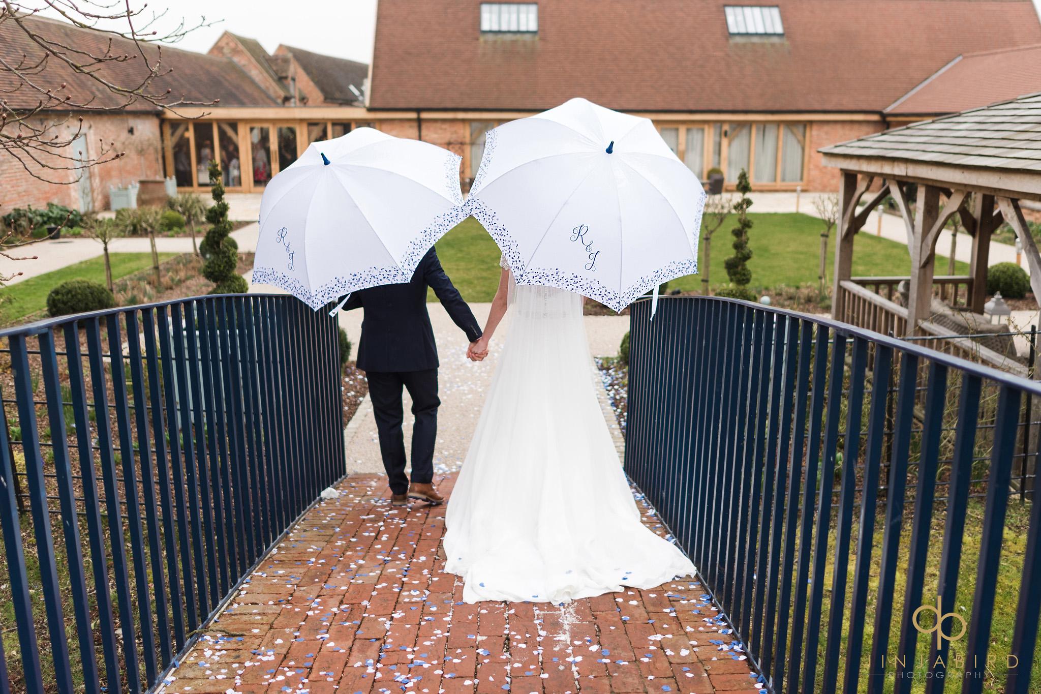 bride and groom in rain bassmead manor