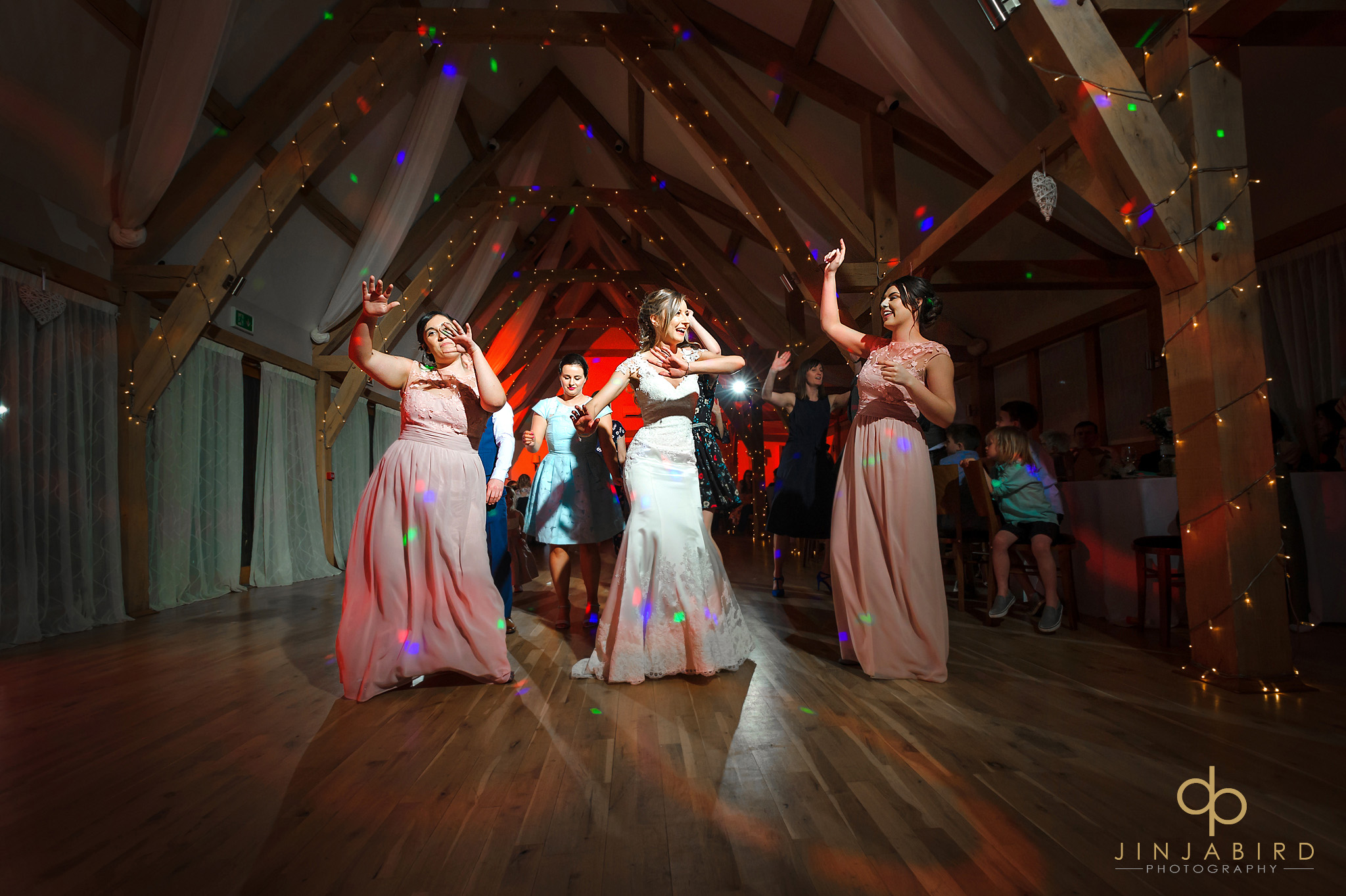 bride dancing with bridesmaids