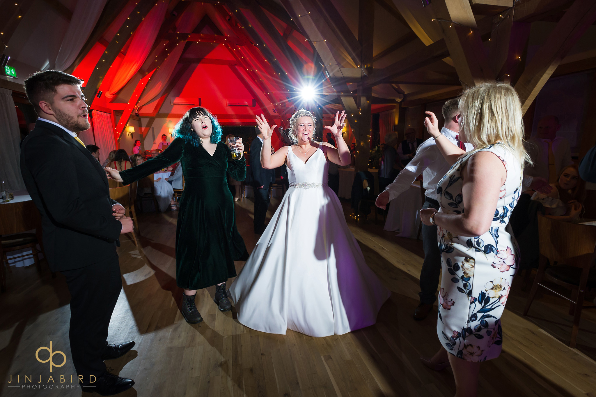 bride dancing with family bassmead manor