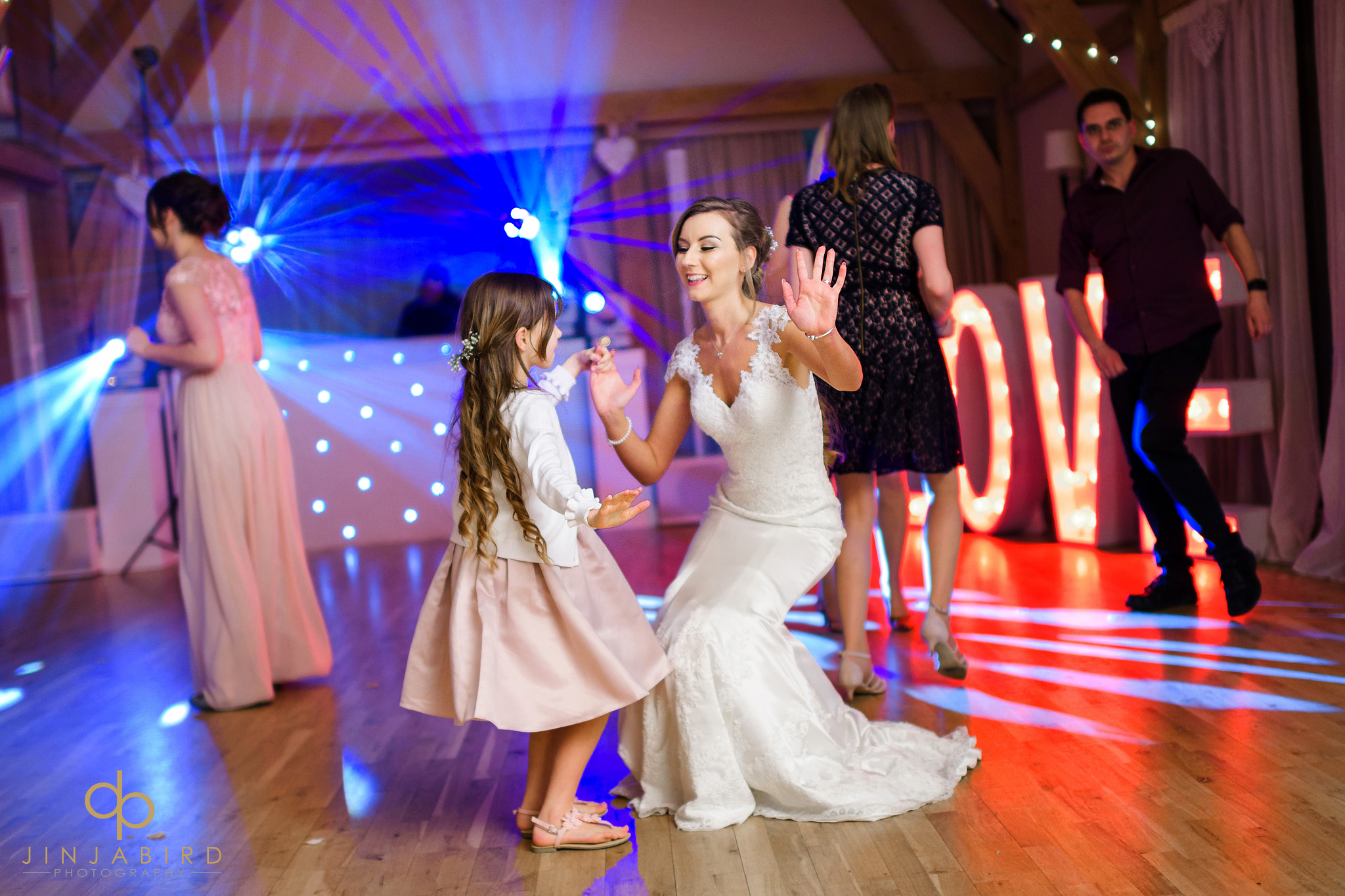 bride dancing with flowergirl