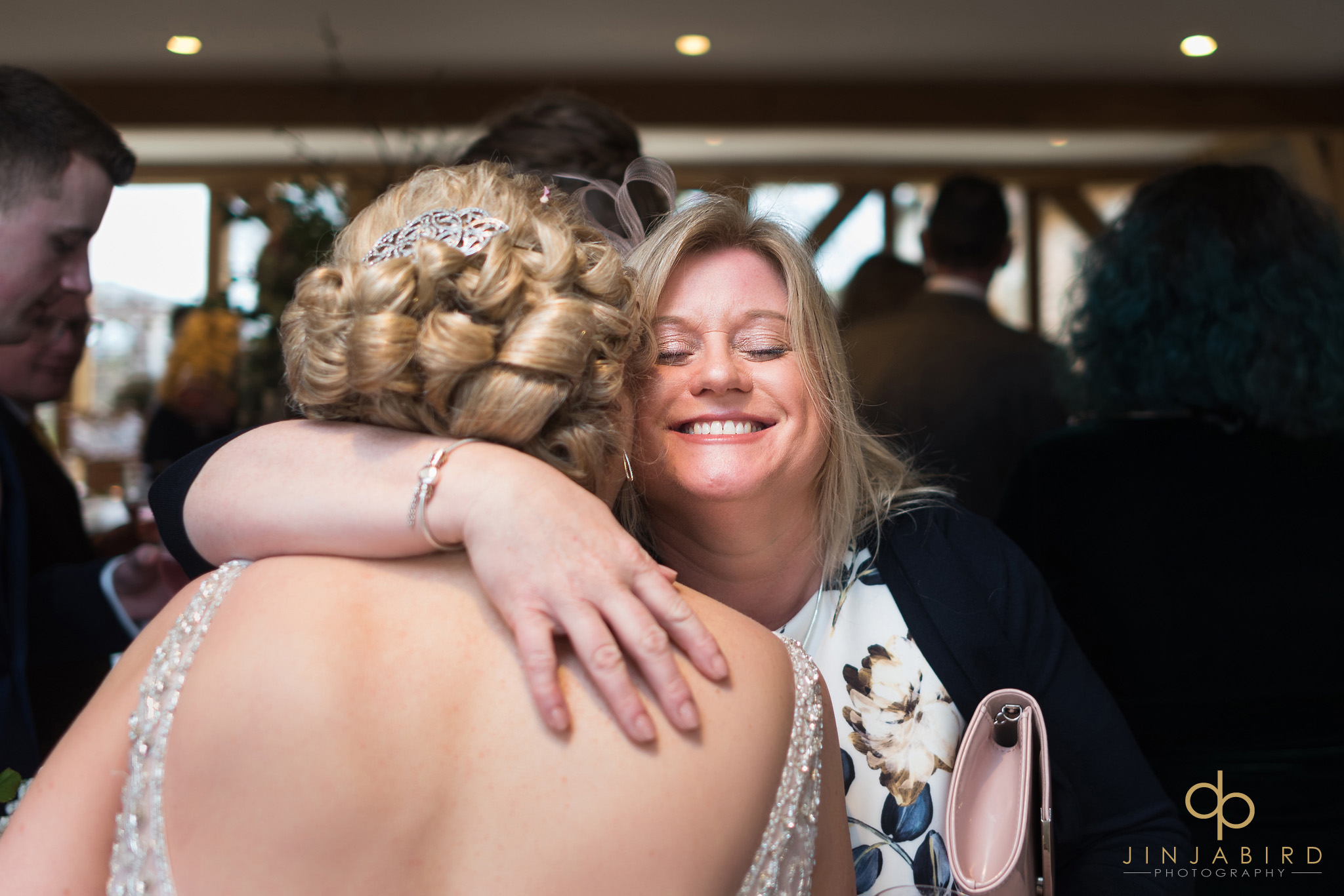 bride getting hug from guest