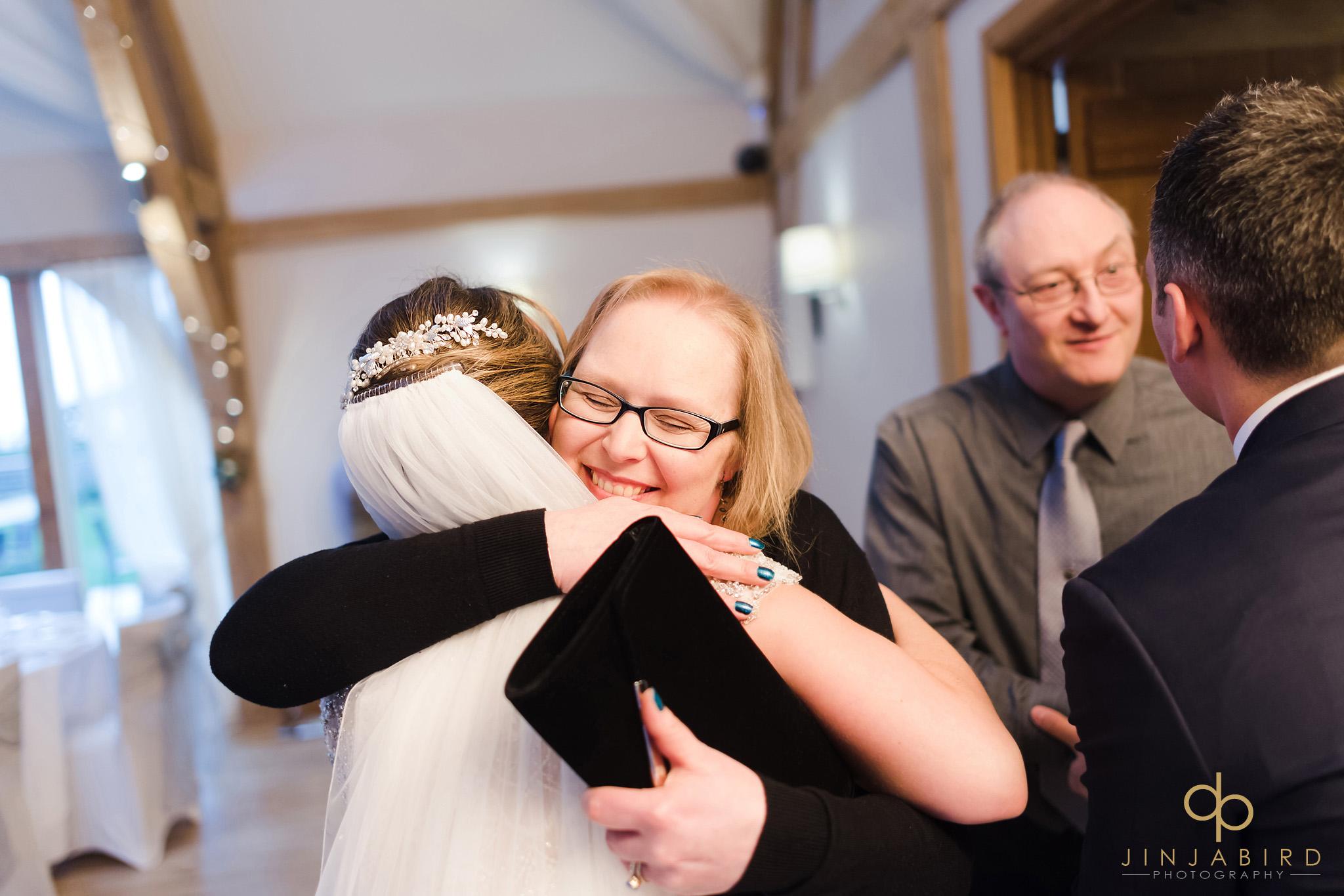 bride hugging guest in receiving line