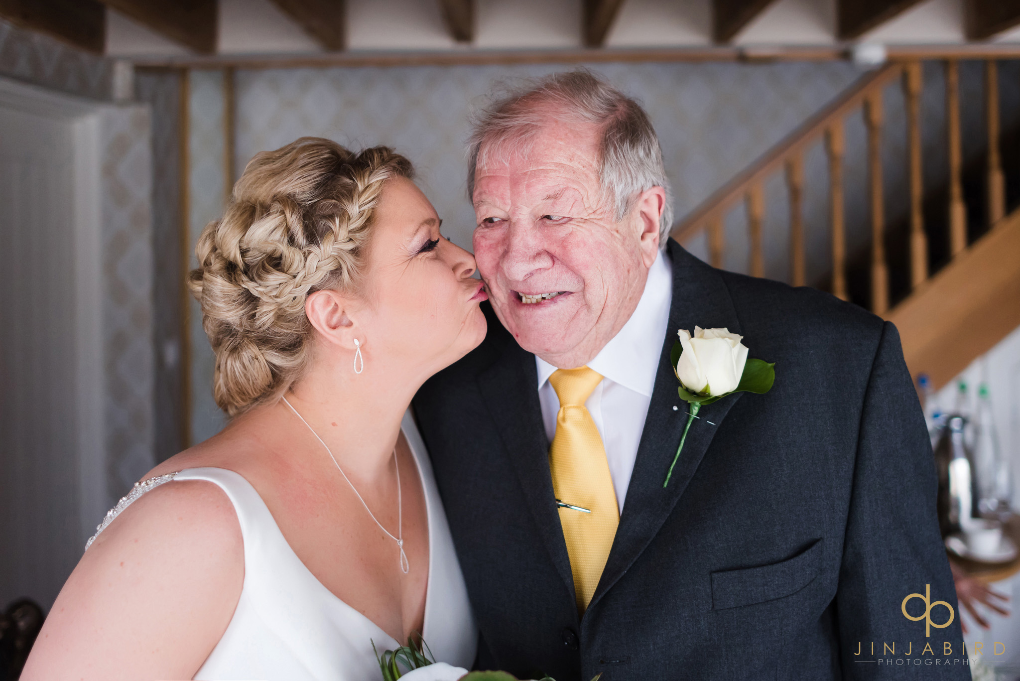 bride kissing dad on cheek