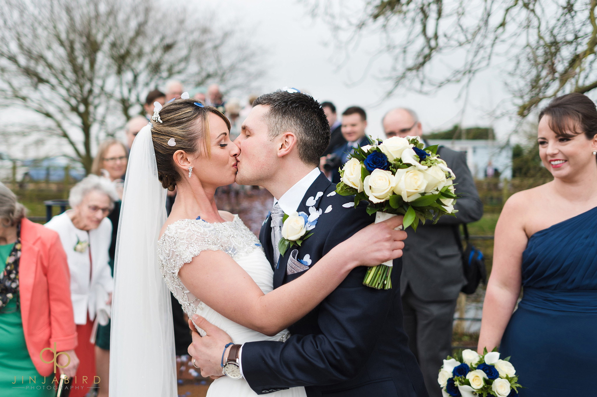 bride kissing groom in garden bassmead manor