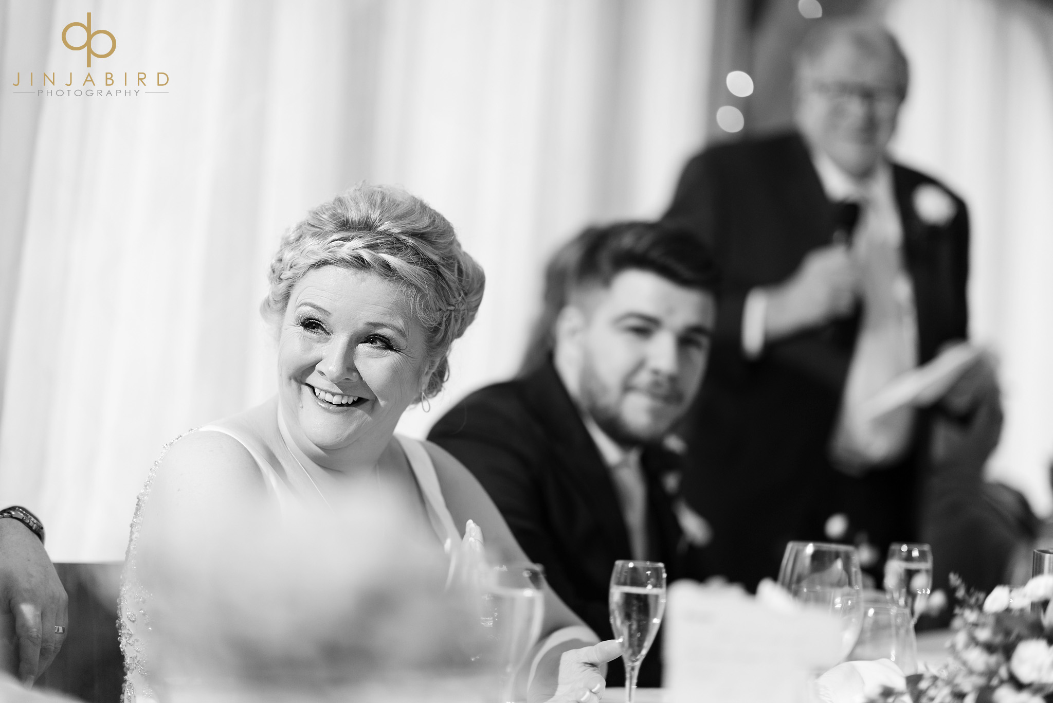 bride laughing during wedding speech