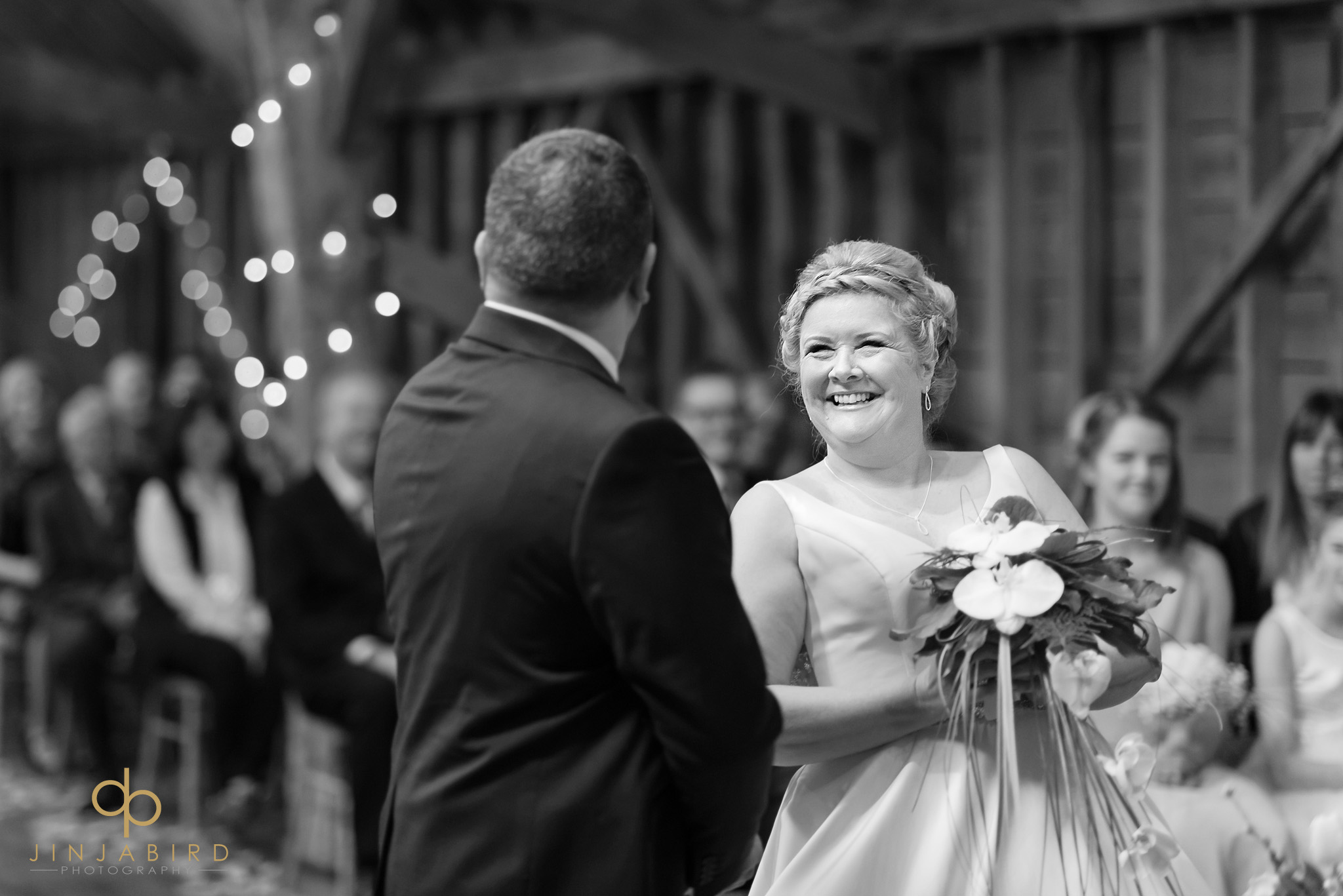 bride smiling at groom