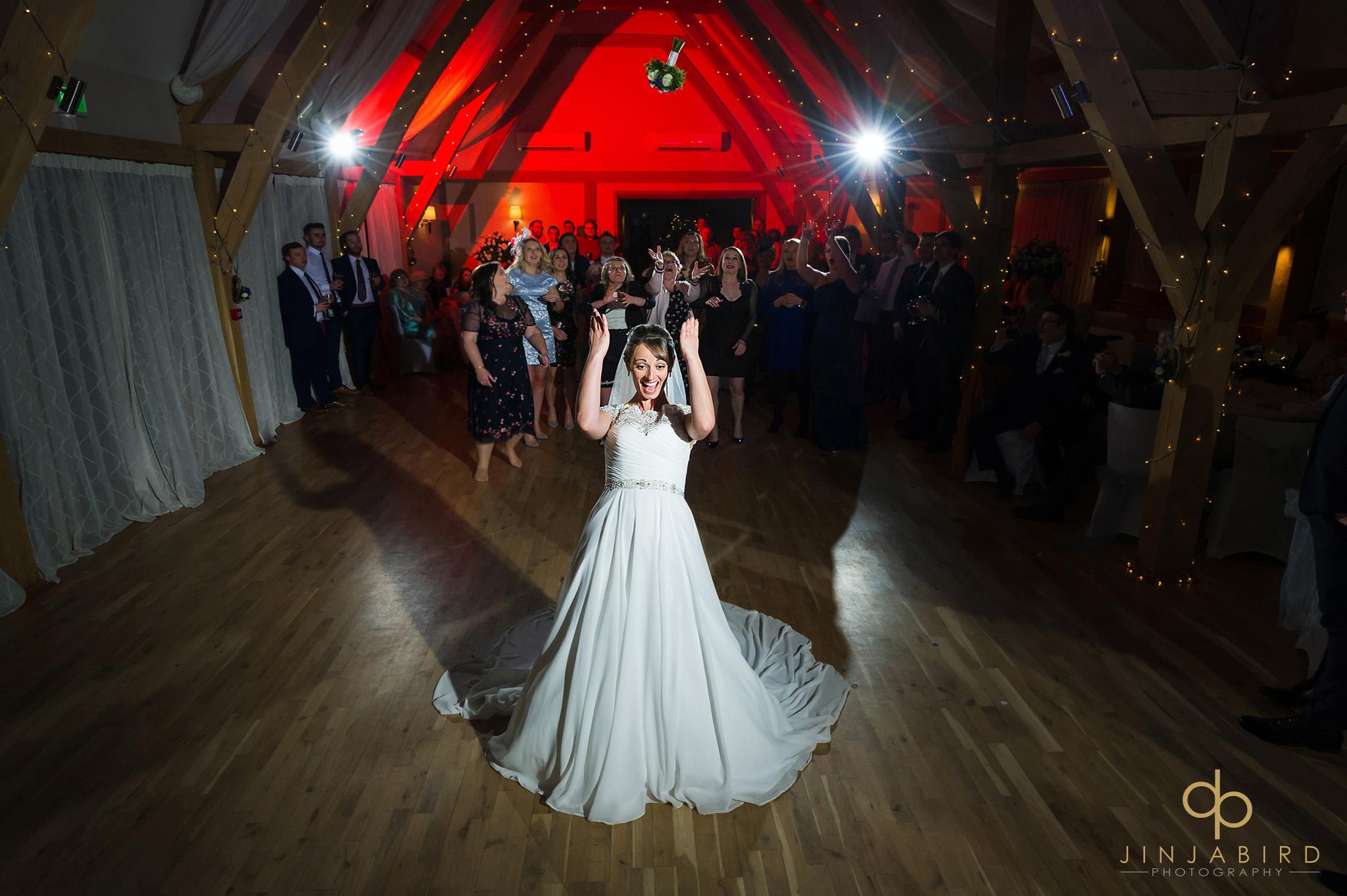 bride throws bouquet bassmead manor