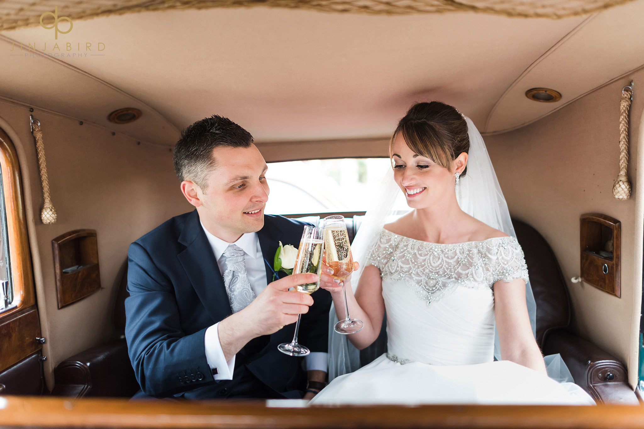 bride with groom toasting in car