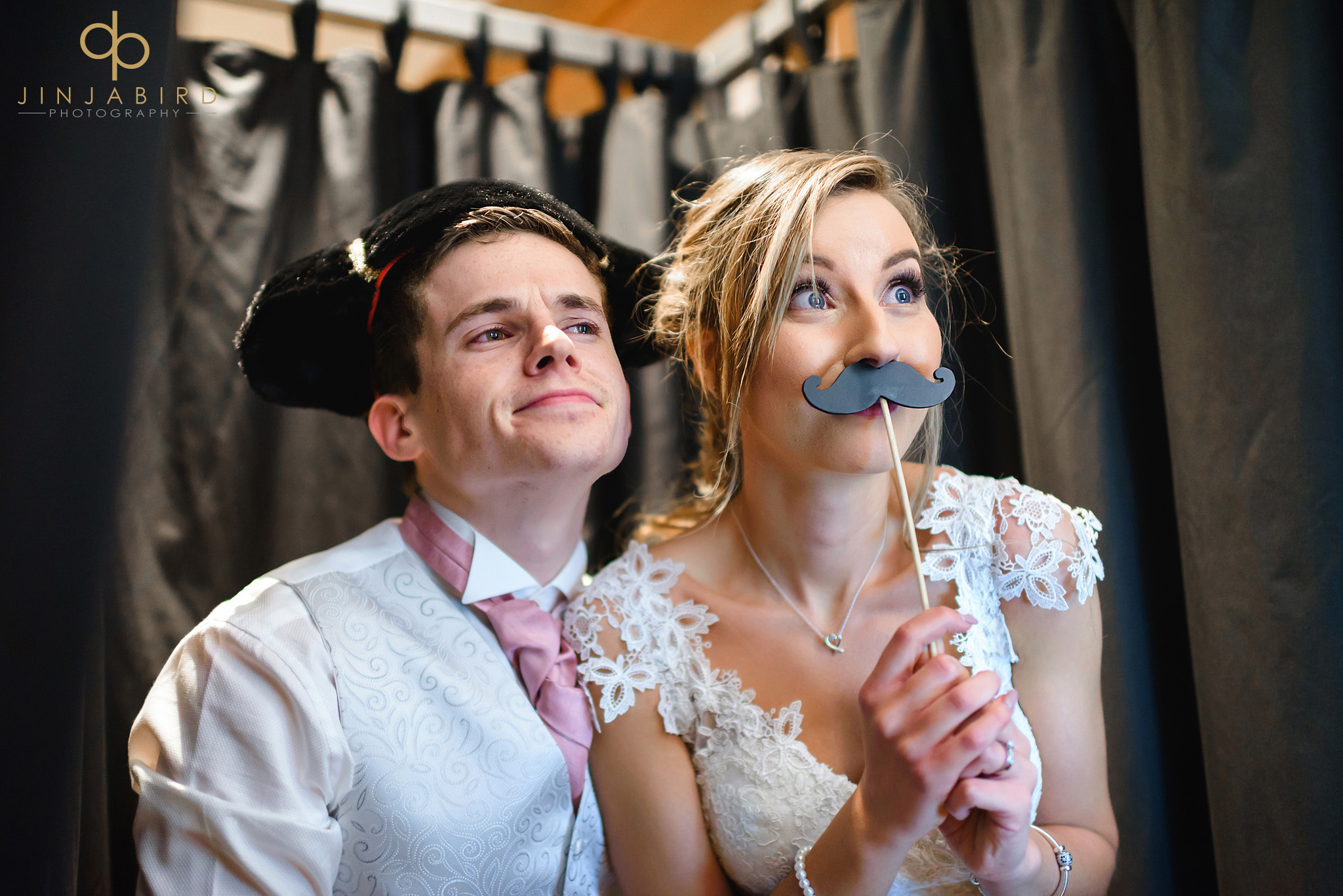 bride and groom in photo booth bassmead manor