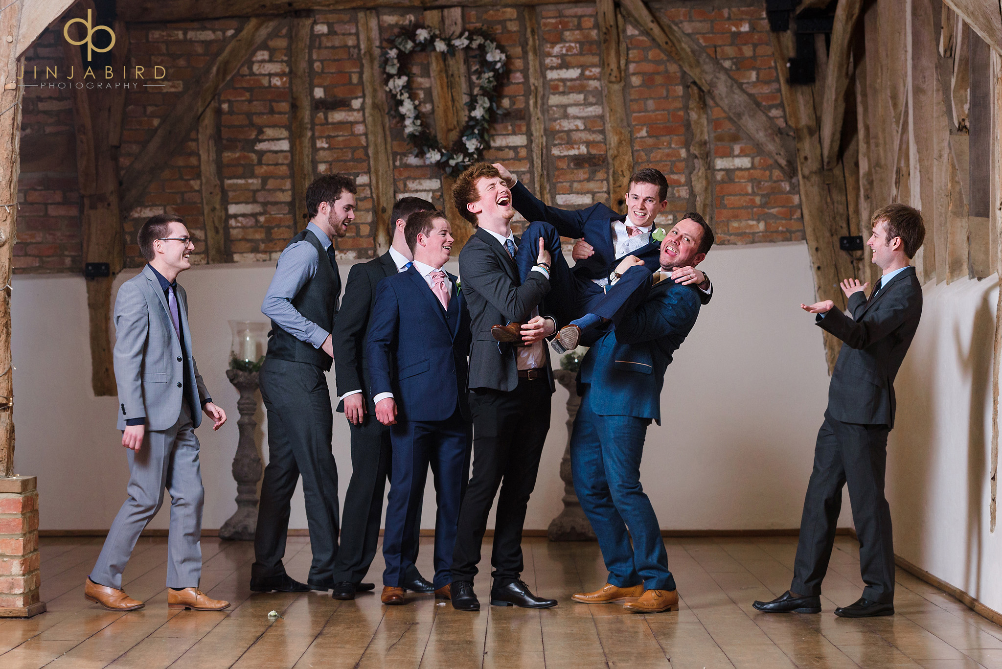 friends holding groom in air