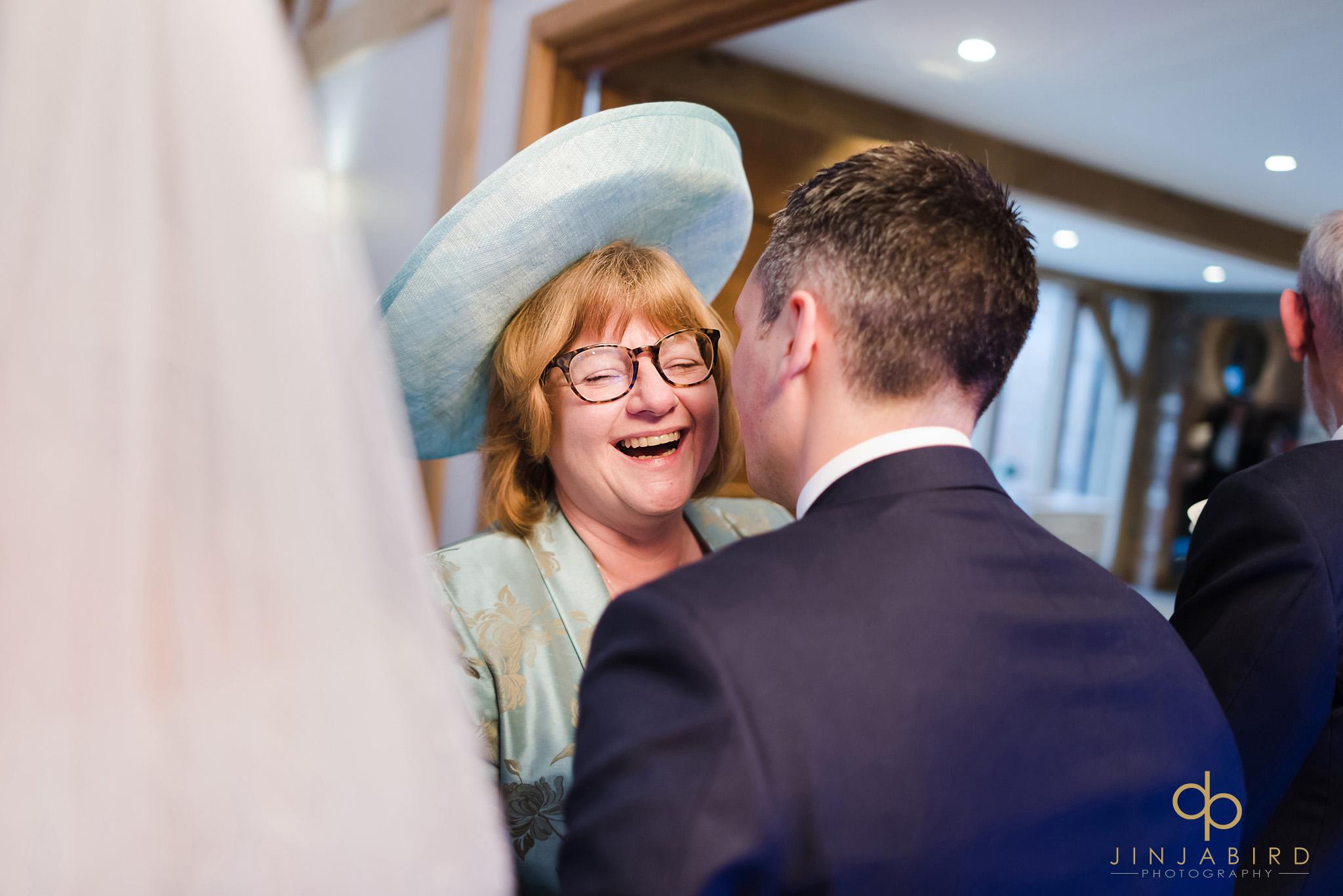 groom kissing guest