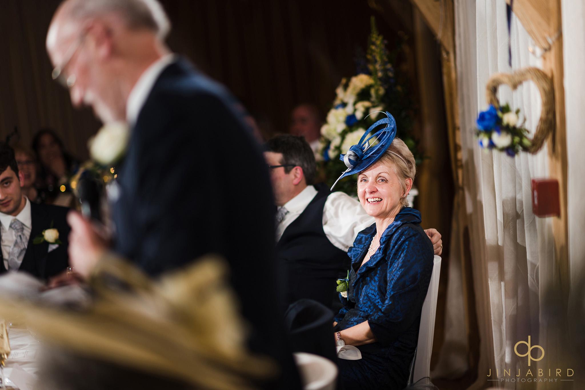 grooms mother listening to speech