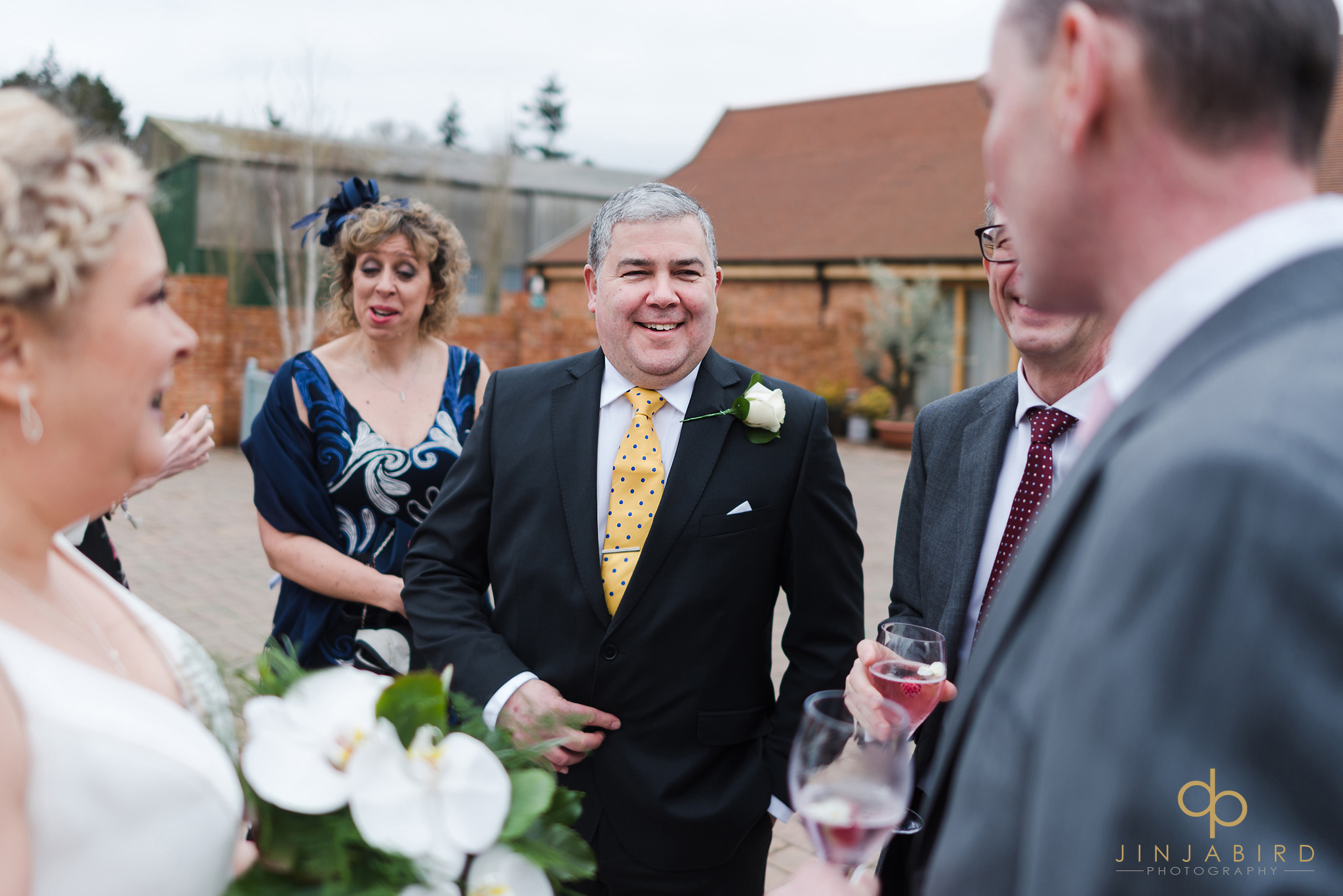 groom talking to wedding guest