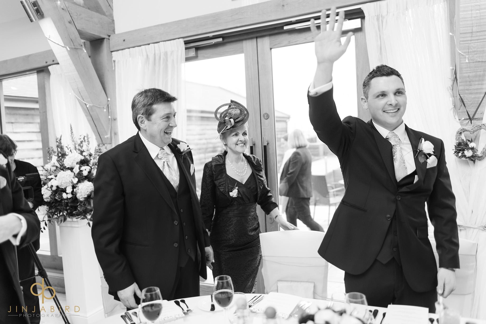 groom waiving