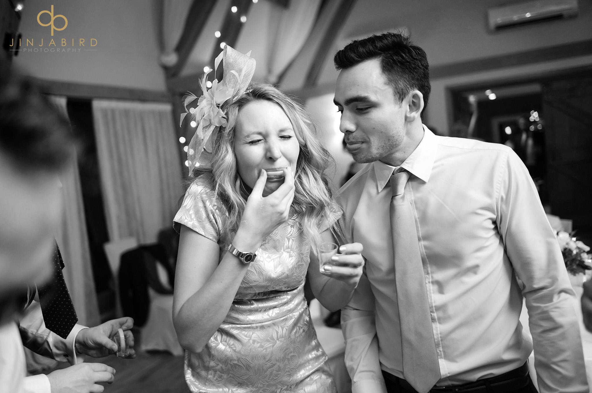 wedding guest drinking shot