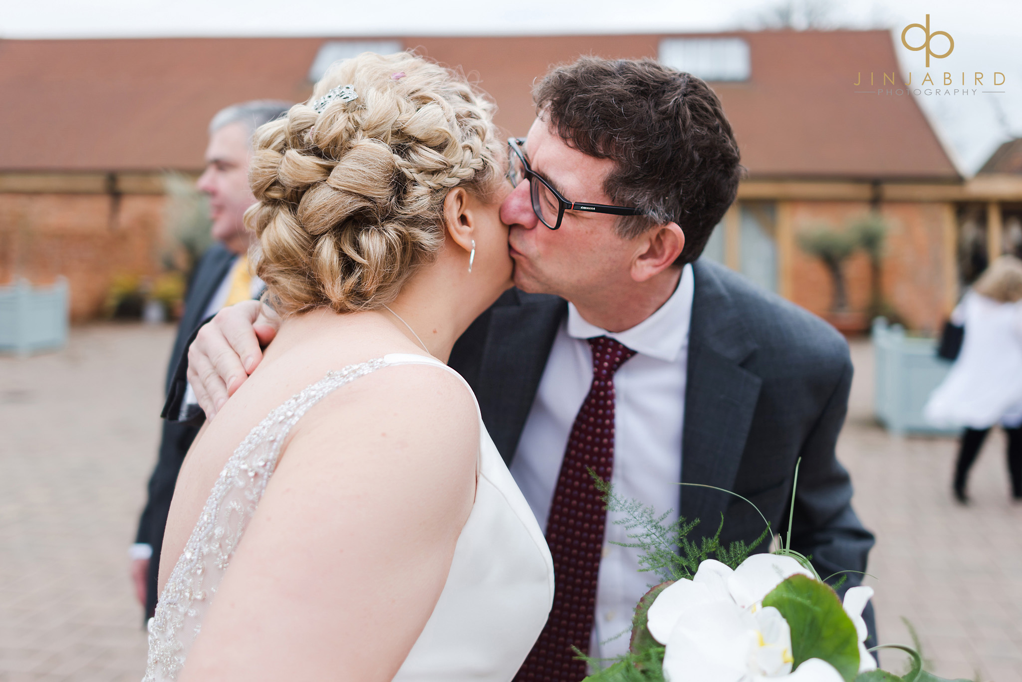 guest kissing bride