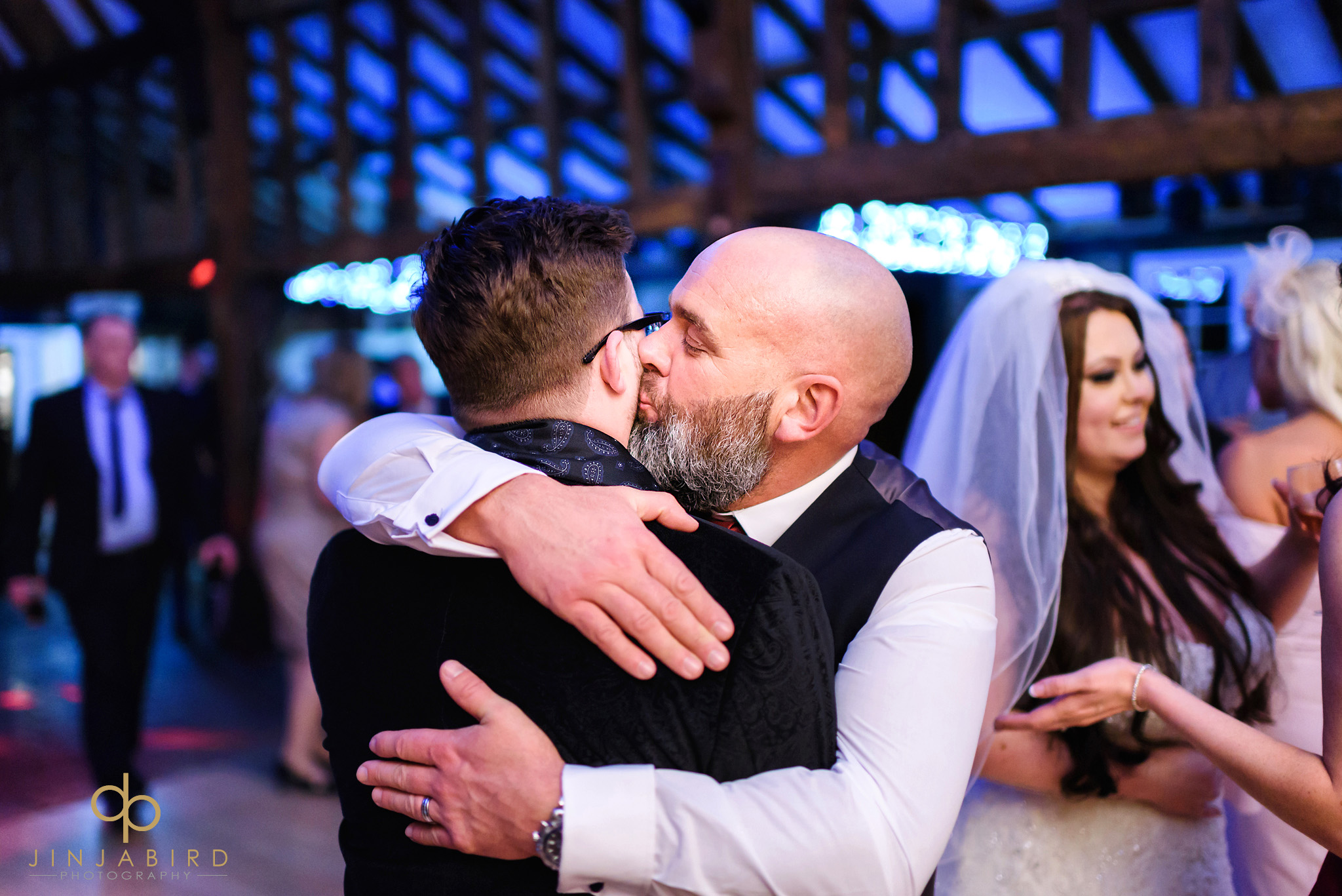 man kissing groom