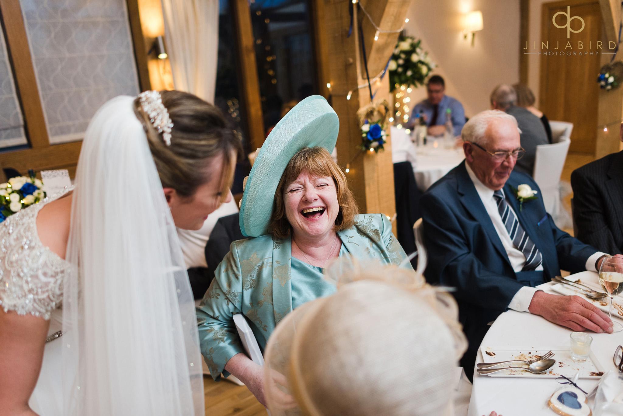 wedding guest in big wedding hat