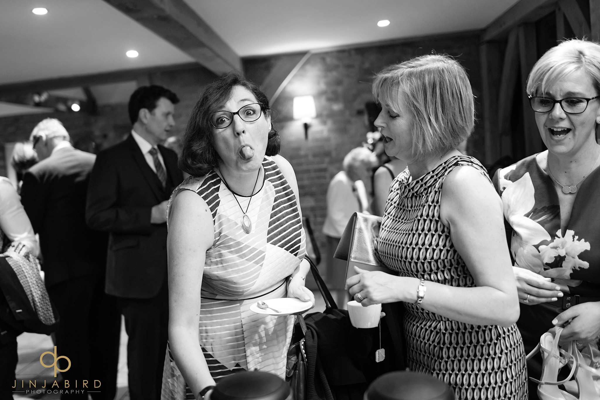 wedding guest sticking tongue out