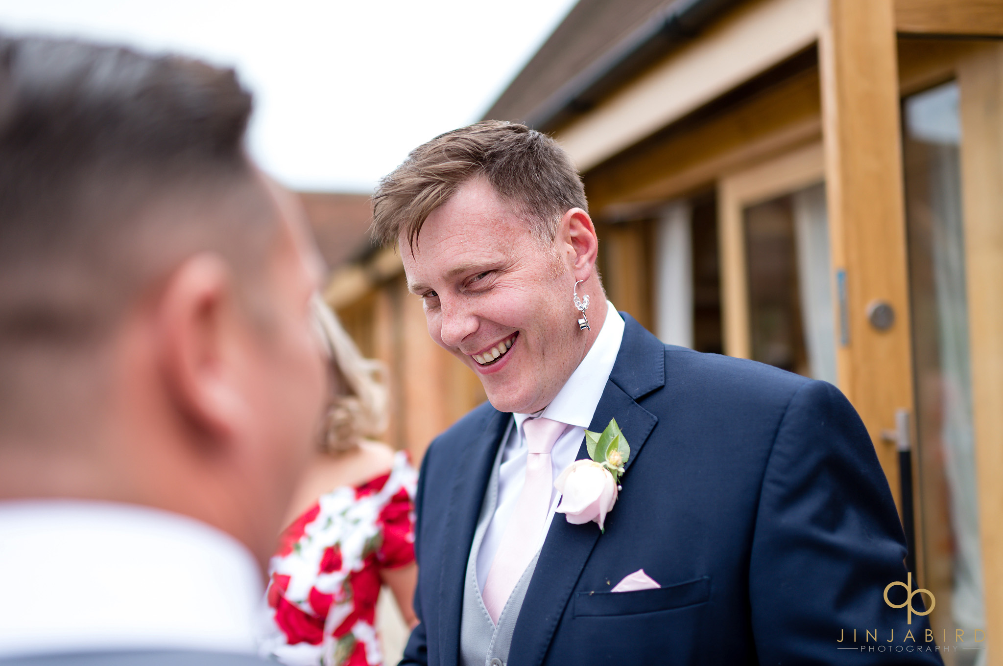 best man wearing earring