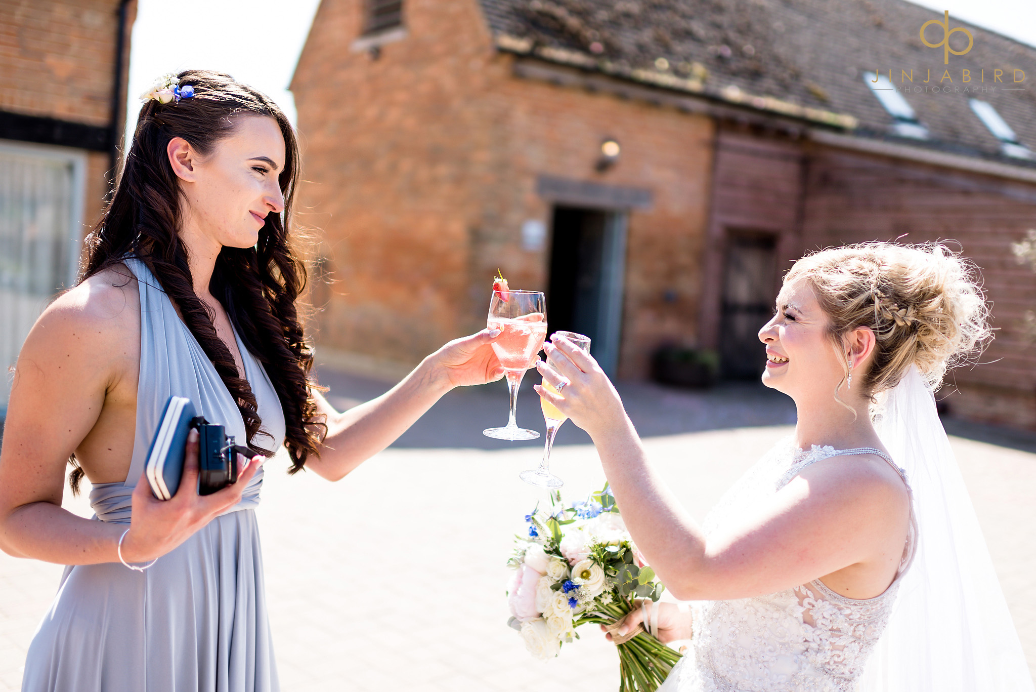 bride drinking with bridesmaids