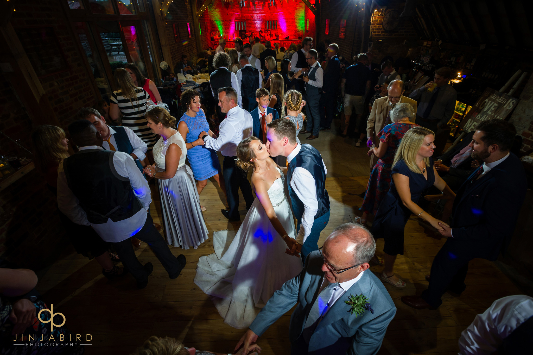 bride and groom dancing thatch barn yelling