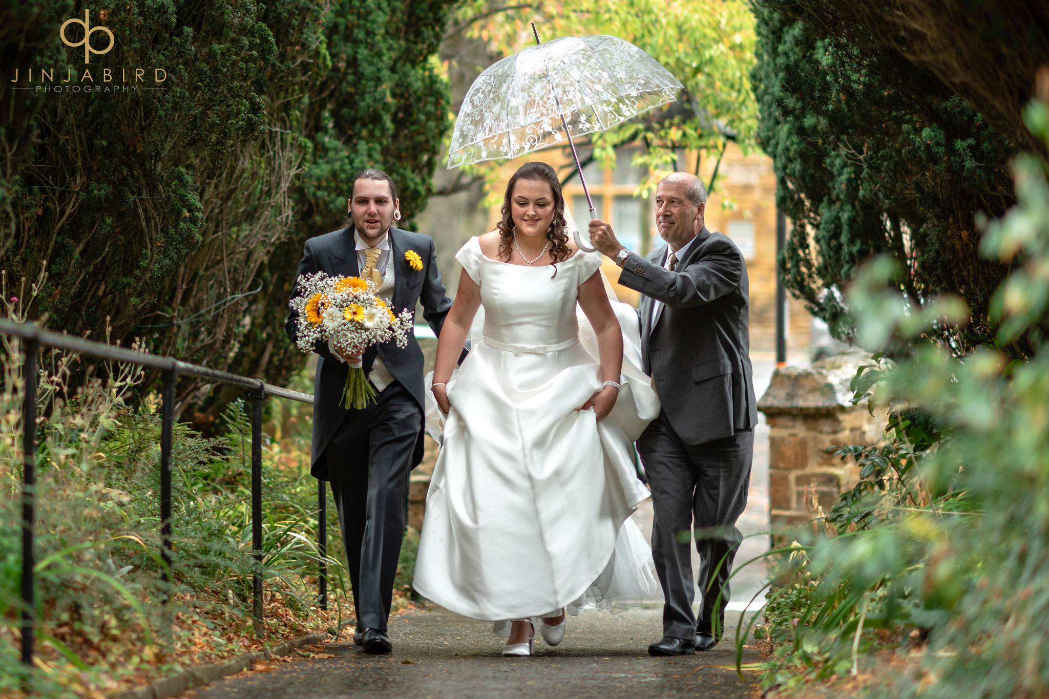 bride arriving in rain