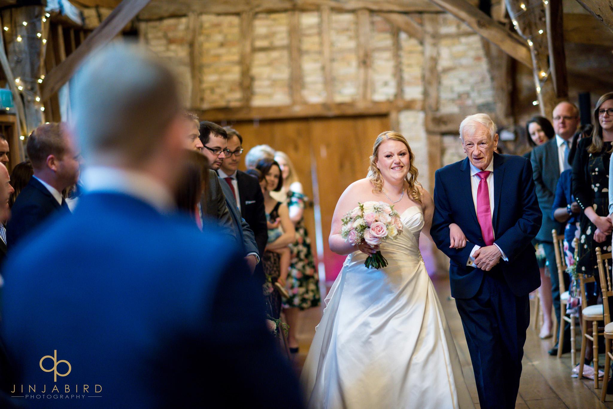 bride coming down aisle bassmead manor