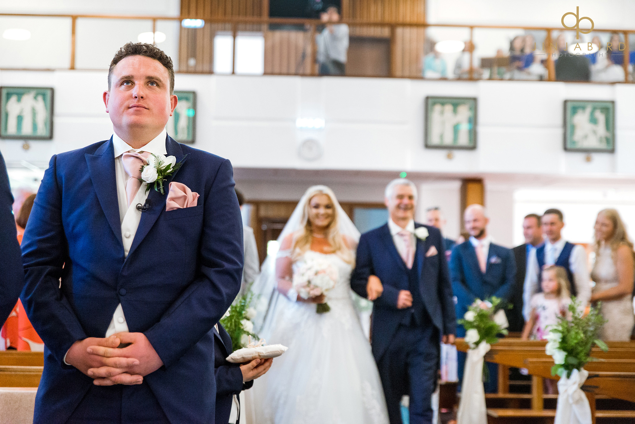bride coming down aisle with father