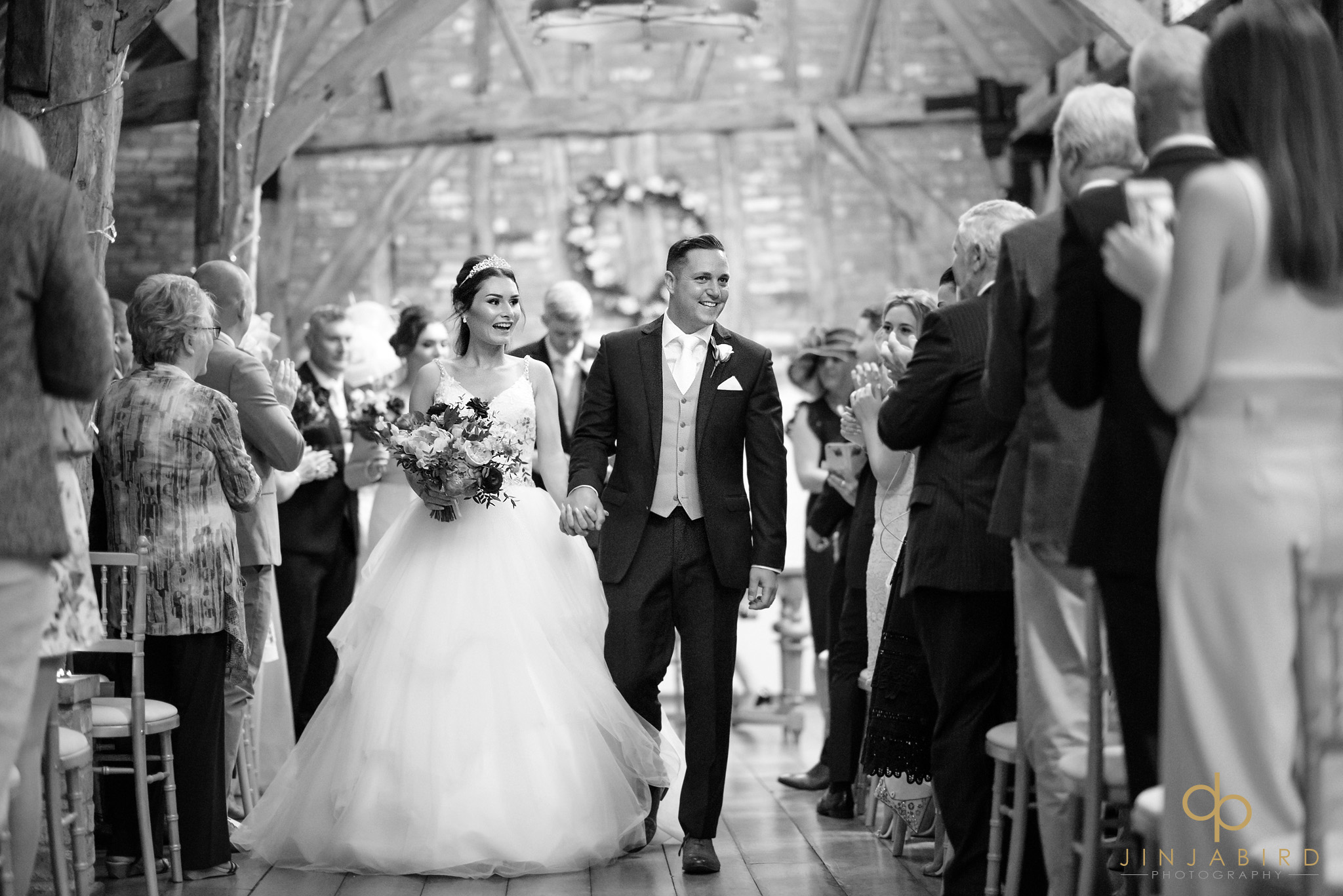 bride coming down aisle with groom bassmead manor