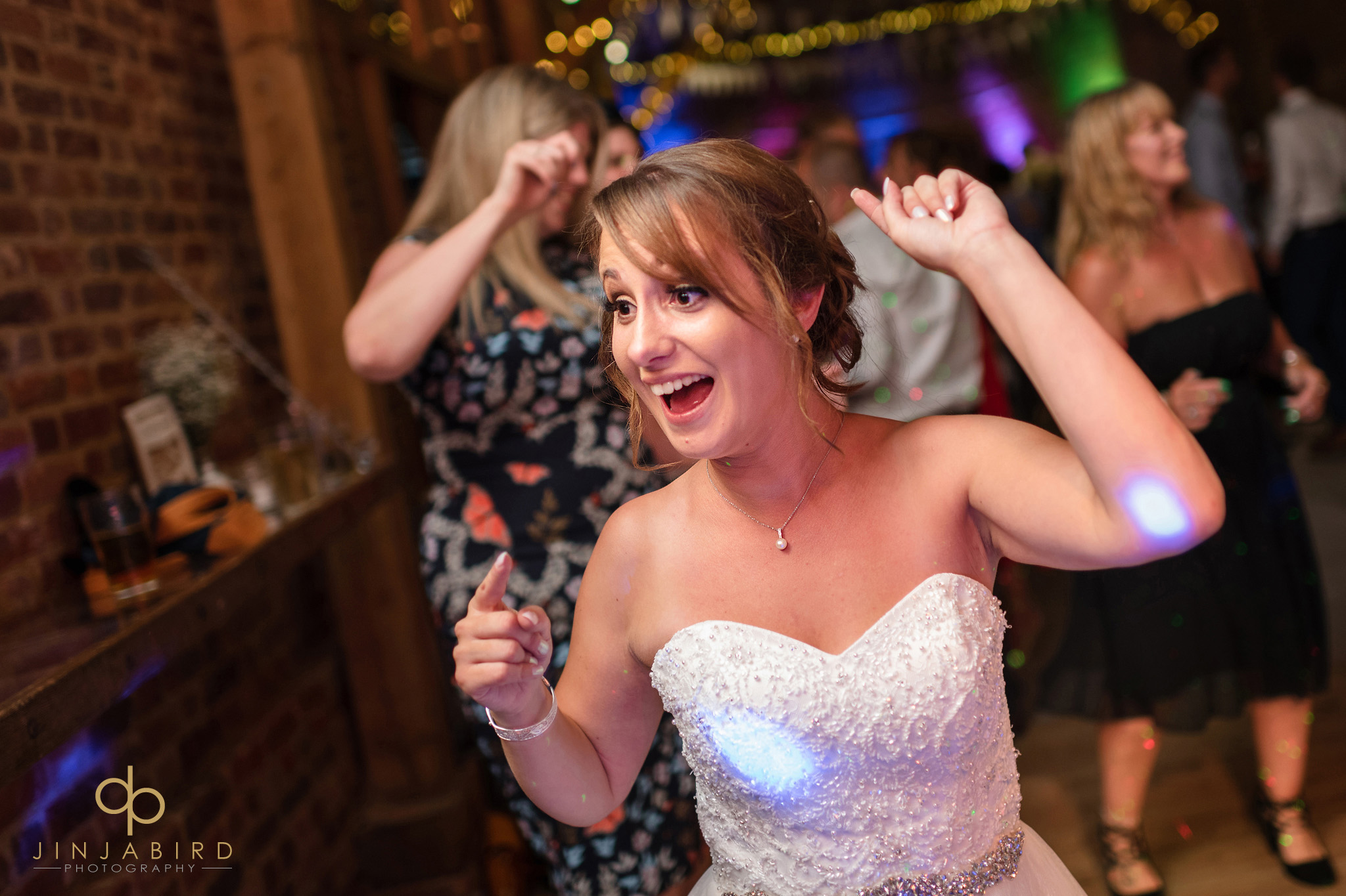 bride dancing thatch barn yelling