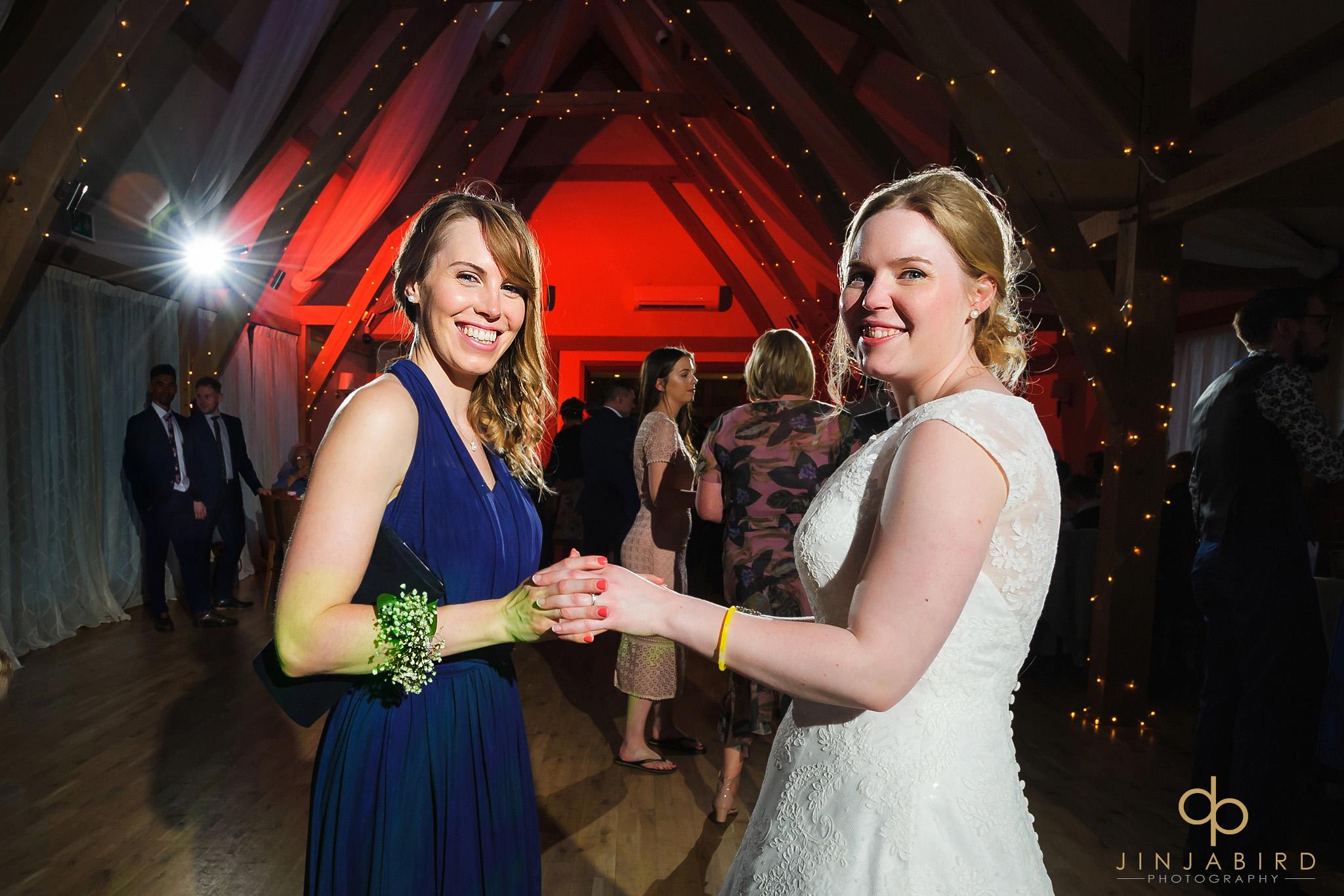 bride dancing with bridesmaid